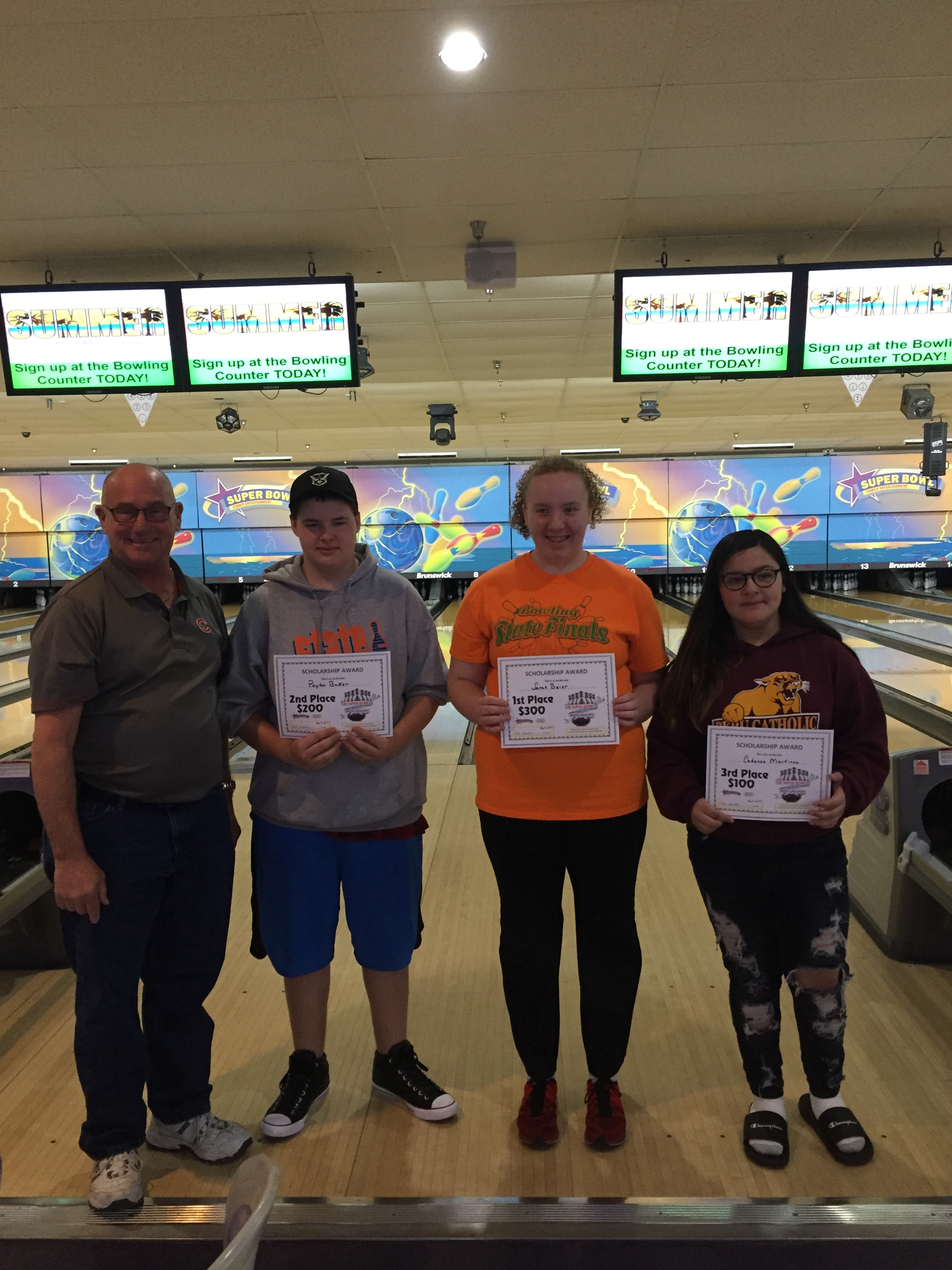 (L - R) Bob Stubler, Age 12 and over winners - Peyton Baker 2nd, Sarah Beier 1st, Cadence Martinez 2nd.