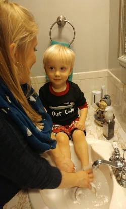 washing feet in sink.jpg