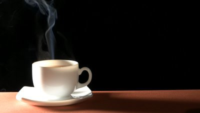 stock-footage-cup-of-hot-drink-with-steam-over-black-background.jpg