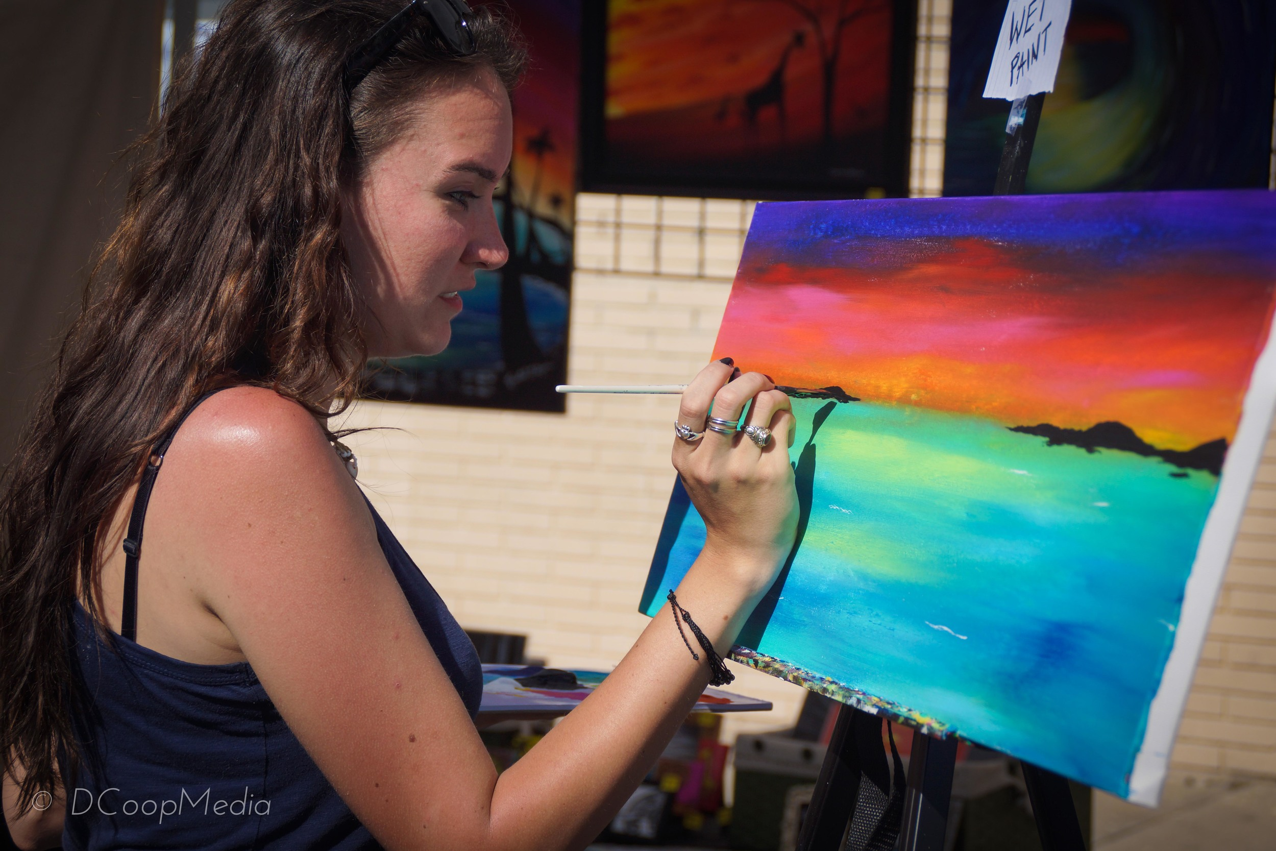 Artist Krystal Dyer concentrating on the horizon.