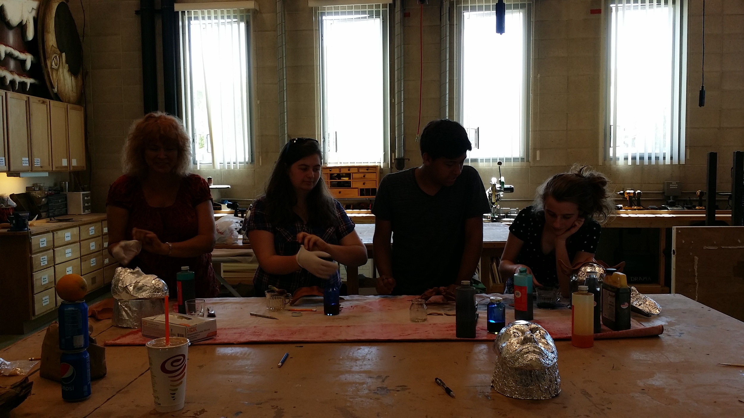 After waiting a day for their masks to dry, the group mixes their dye and stains their final masks.