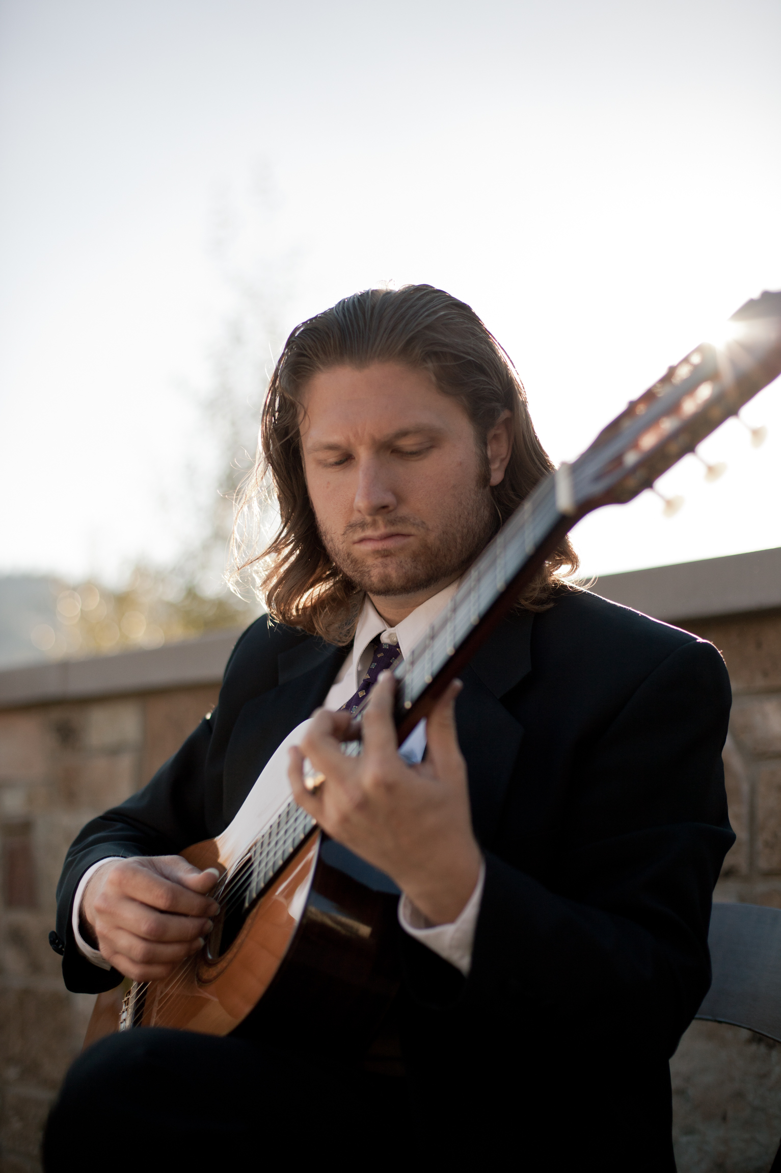 A classical guitarist is an easy way to make your ceremony special