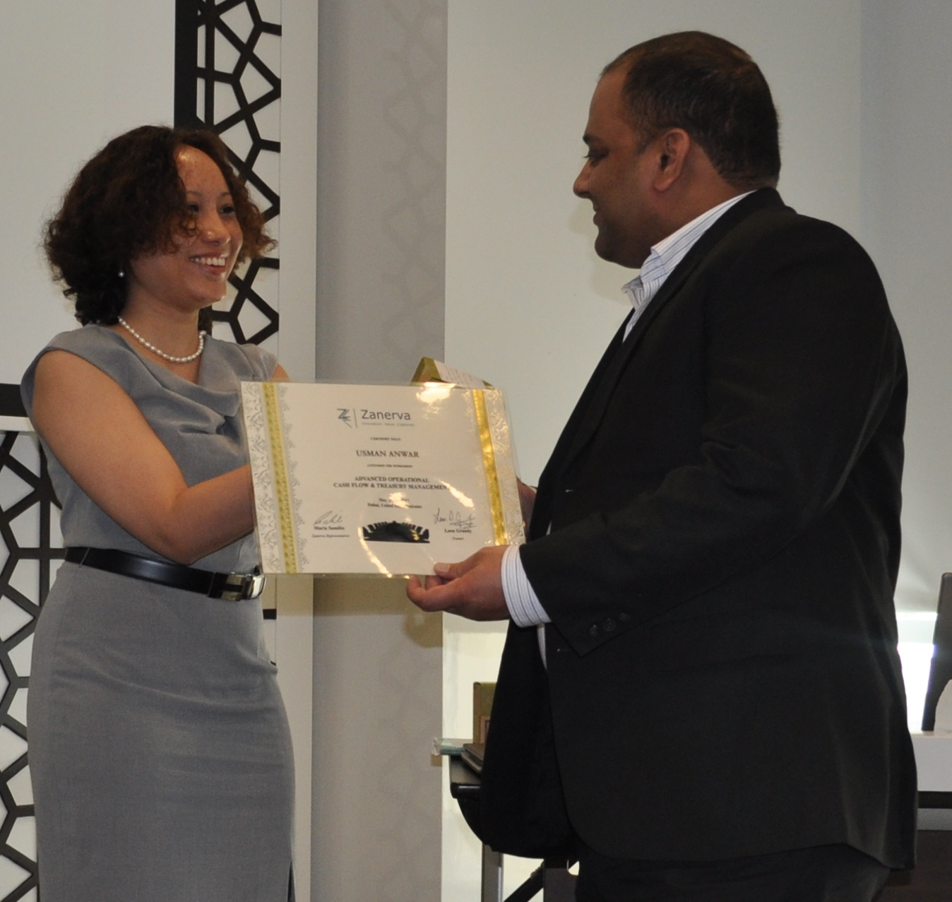 Usman Anwar (Treasury Manager)   receiving his certificate of workshop participation from  Maria Samilin (Zanerva Director of New Ideas)