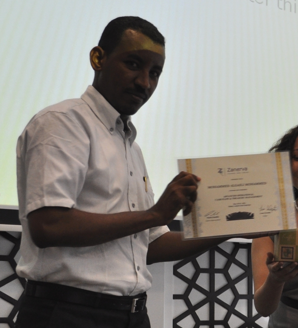 Mohammed Algaili Mohammed (Senior Budget & Cost Accountant)    shows the certificate of workshop participation he received by attending the Advanced Operational Cash Flow & Liquidity Risk Management Workshop in Dubai.