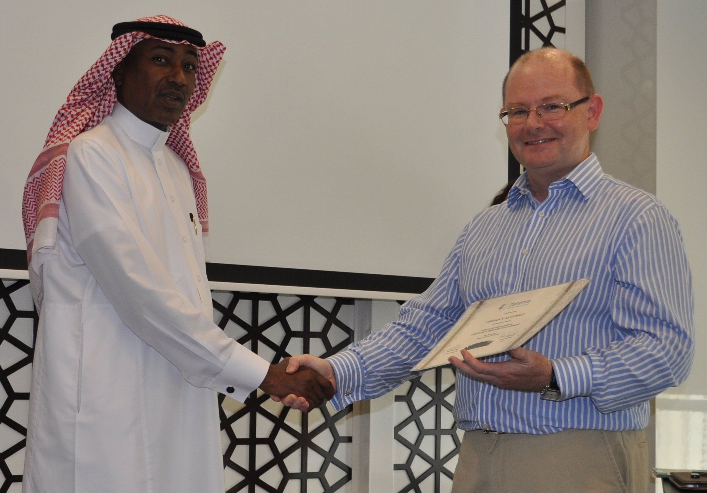 Hassan Y. Al-Sumali (Division Manager Corporate Finance)  receiving his certificate of workshop participation from Leon Grandy (Zanerva Partner Consultant)