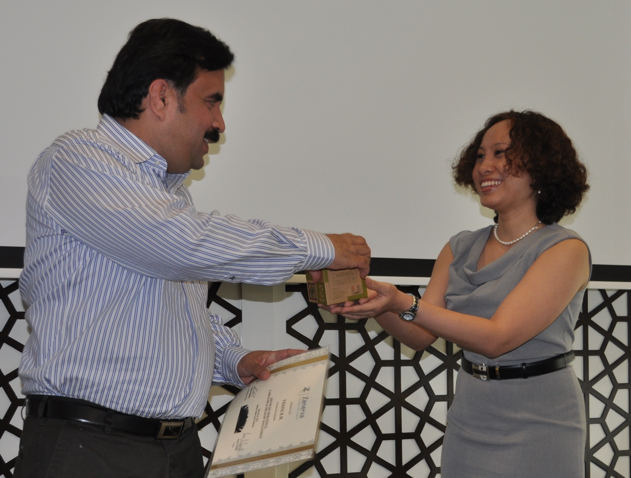 Thaha K.M. (Accounts Section Head)  receiving a gift from Zanerva through Maria Samilin (Zanerva Director of New Ideas) during the workshop on Advanced Operational Cash Flow & Liquidity Risk Management