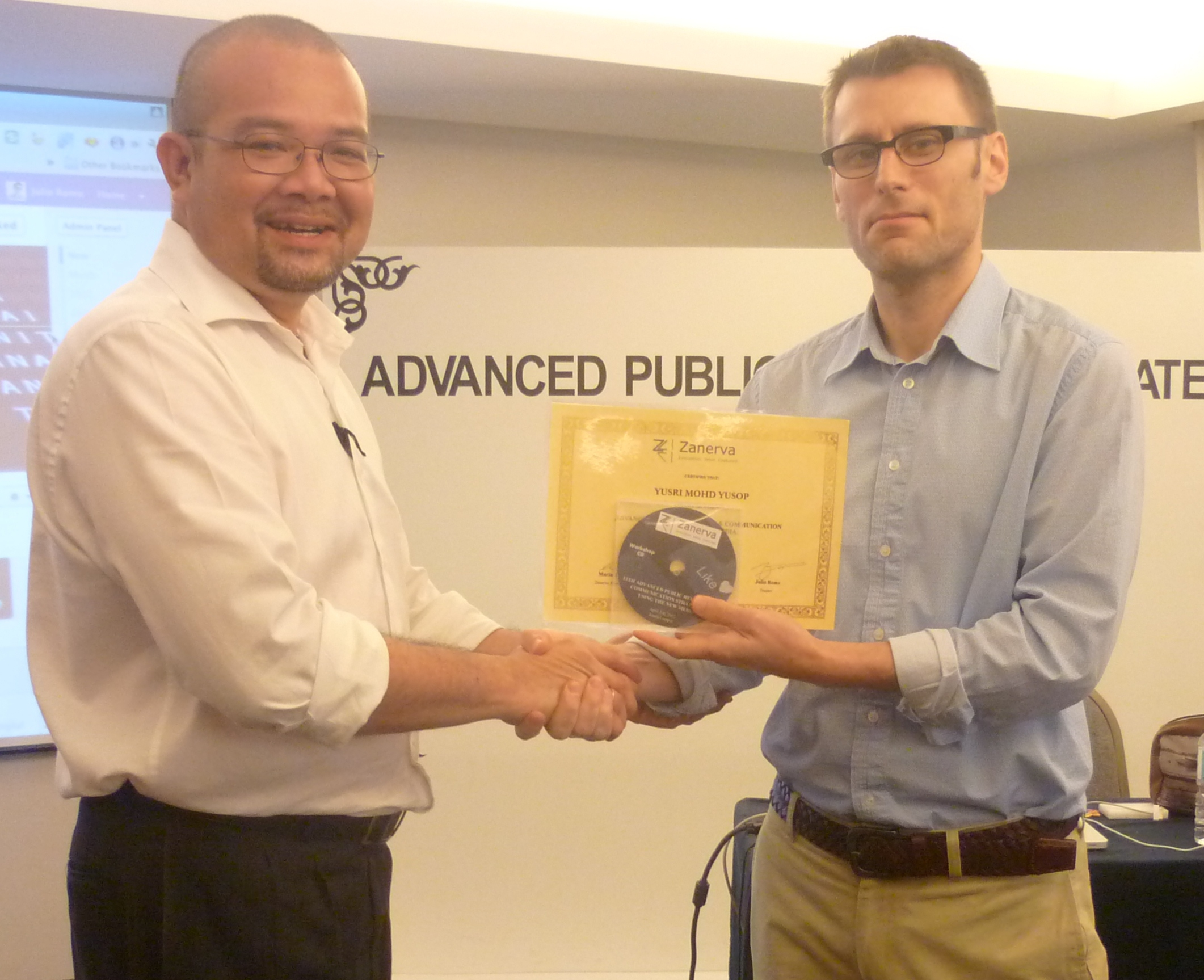 Yusri Mohd Yusop, PR Officer of the United Malays National Organization (UMNO)  receiving his certificate of workshop participation for attending the  Advanced Public Relations and Communication Strategies Using the New Media Workshop in Kuala Lumpur