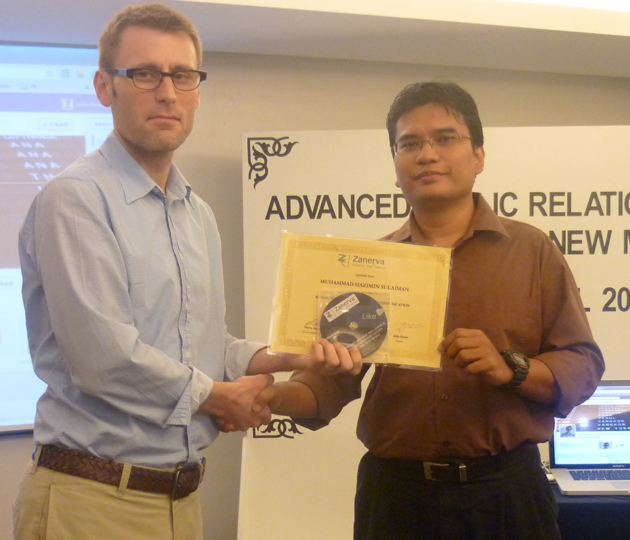 Muhammad Hazimin Sulaiman, Deputy Manager of Corp Comm. at Suruhanjaya Penangkutan Awam Darat (SPAD)  receiving his certificate of workshop participation from Julio Romo (Zanerva Partner Consultant) for attending the Advanced Public Relations & Communication Strategies Using the New Media in Kuala Lumpur