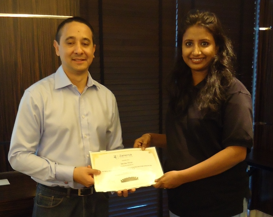 Devika Vittal, Customer Care Manager at the UAE Exchange  receiving her certificate for attending the workshop on Best Practices in Social Media Strategies for Enhanced Customer Service from Guy Stephens (Zanerva Partner Consultant)