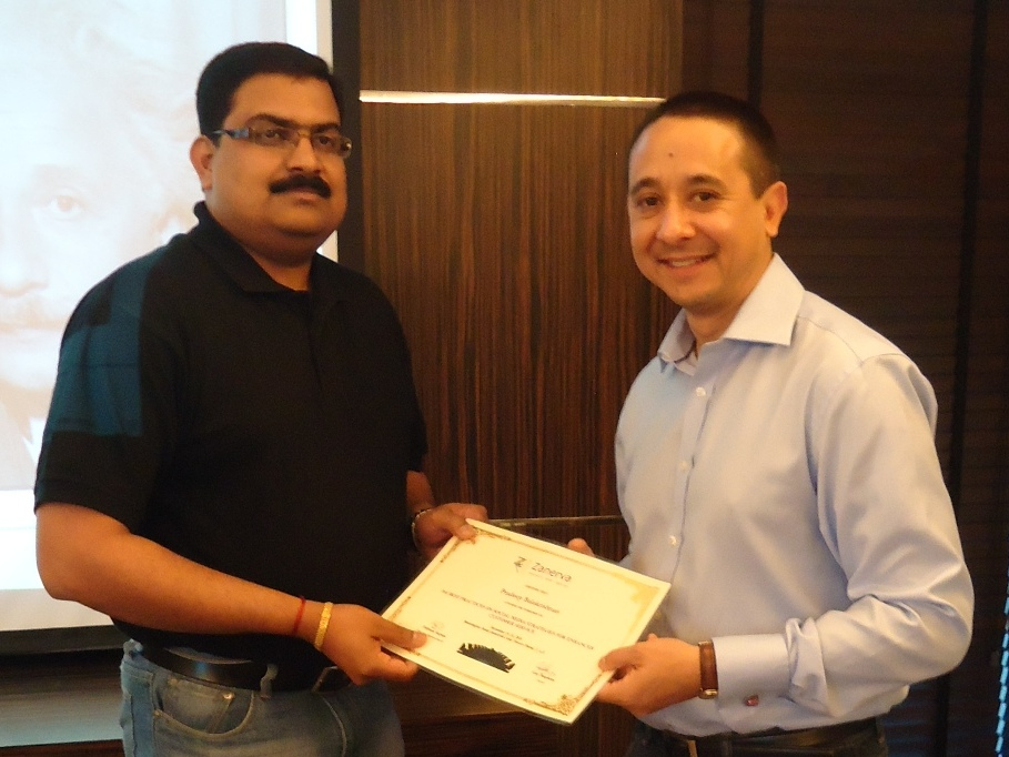 Pradeep Balakrishnan - Customer Care Manager for the UAE Exchange  receiving his certificate of workshop participation from Guy Stephens (Zanerva Partner Consultant)