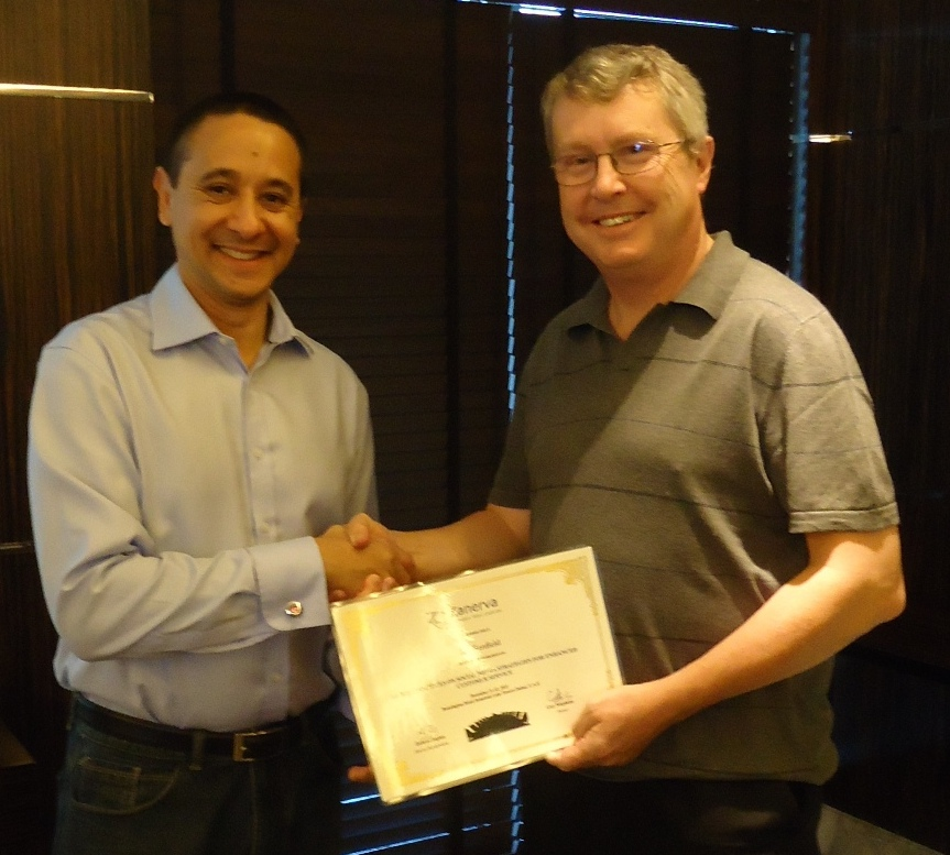 Ian Benfield -Director of Customer Affairs,Authority for Electricity Oman  receiving his certificate of workshop participation from Guy Stephens (Zanerva Partner Consultant)
