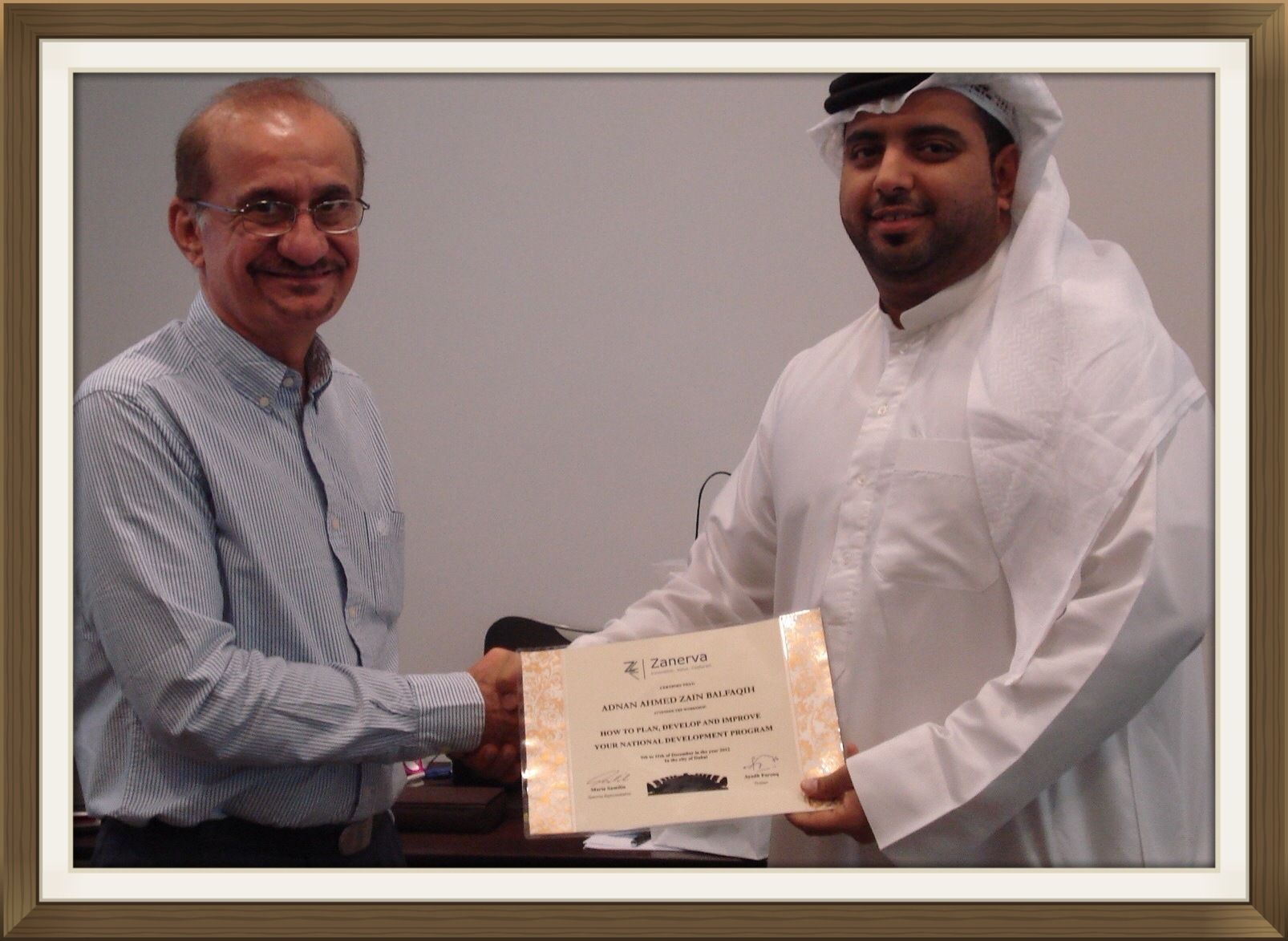 "Adnan Ahmed Zain Balfaqih - HR Superintendent at National Petroleum Construction Company UAE receiving his certificate of workshop participation from Ayadh Farooq during the ""How to Improve Your National Development Program Workshop"" held in Dubai"