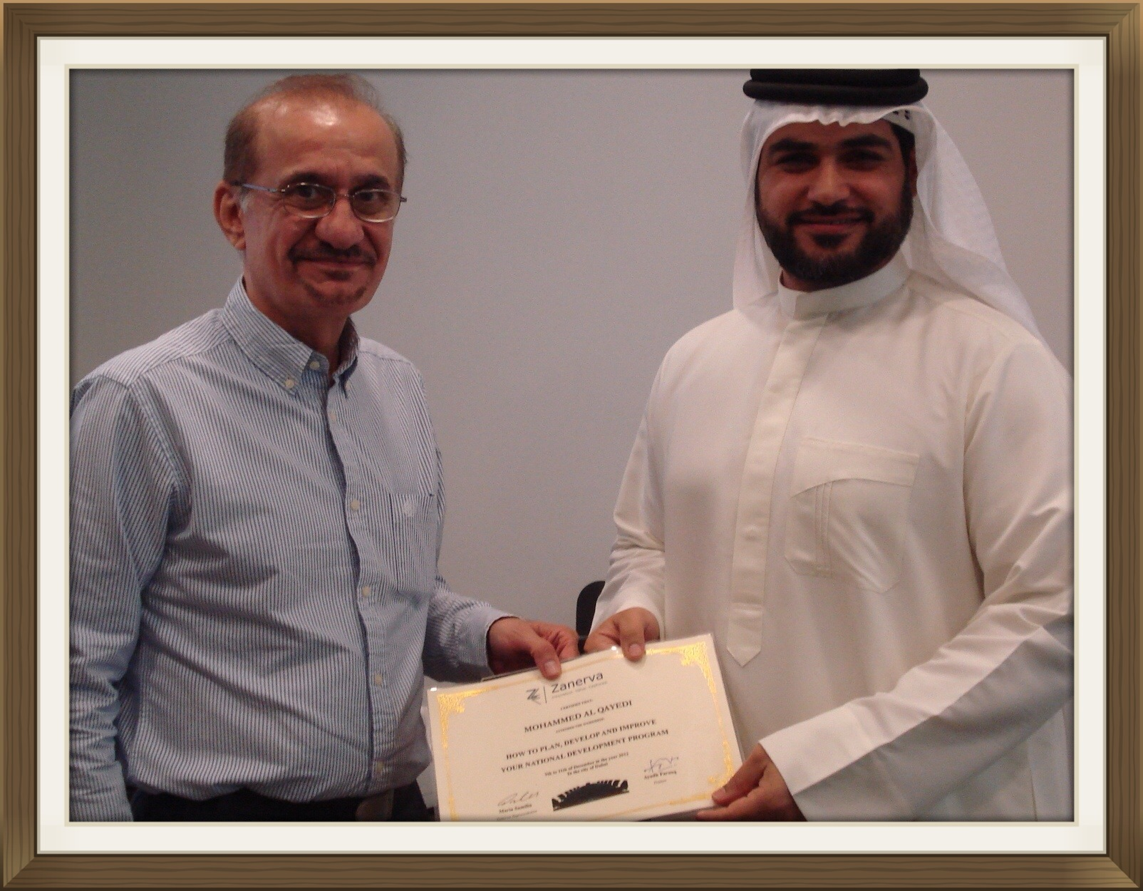 "Mohammed Al Qayedi - Human Resource Manager at National Petroleum Construction Company received his certificate of workshop participation from Ayadh Farooq during the ""How to Improve Your National Development Program Workshop"" held in Dubai"