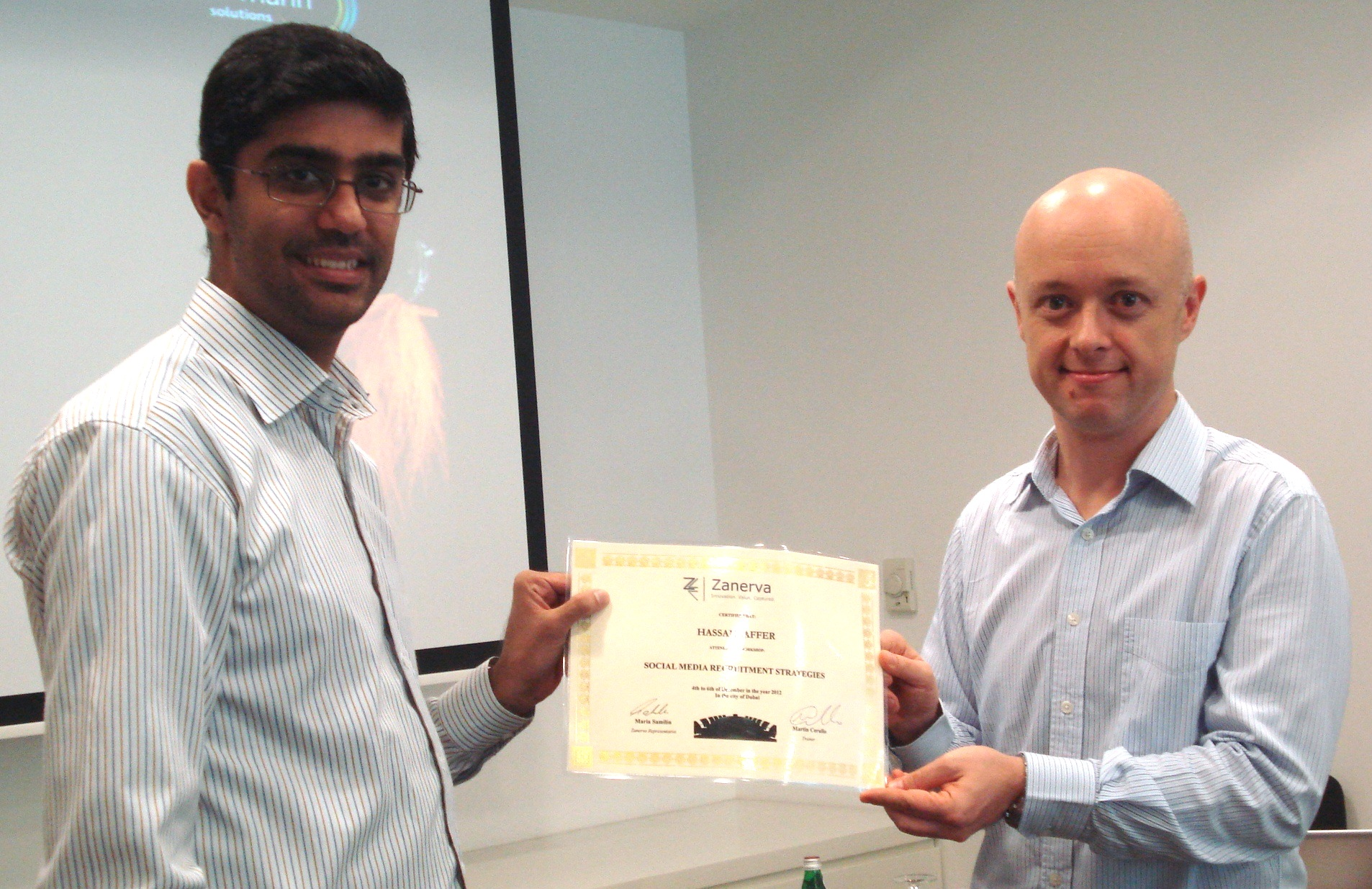 Hassan Jafferreceiving his certificate of workshop participation from Martin Cerullo for attending the Social Media Recruitment Workshop in Dubai
