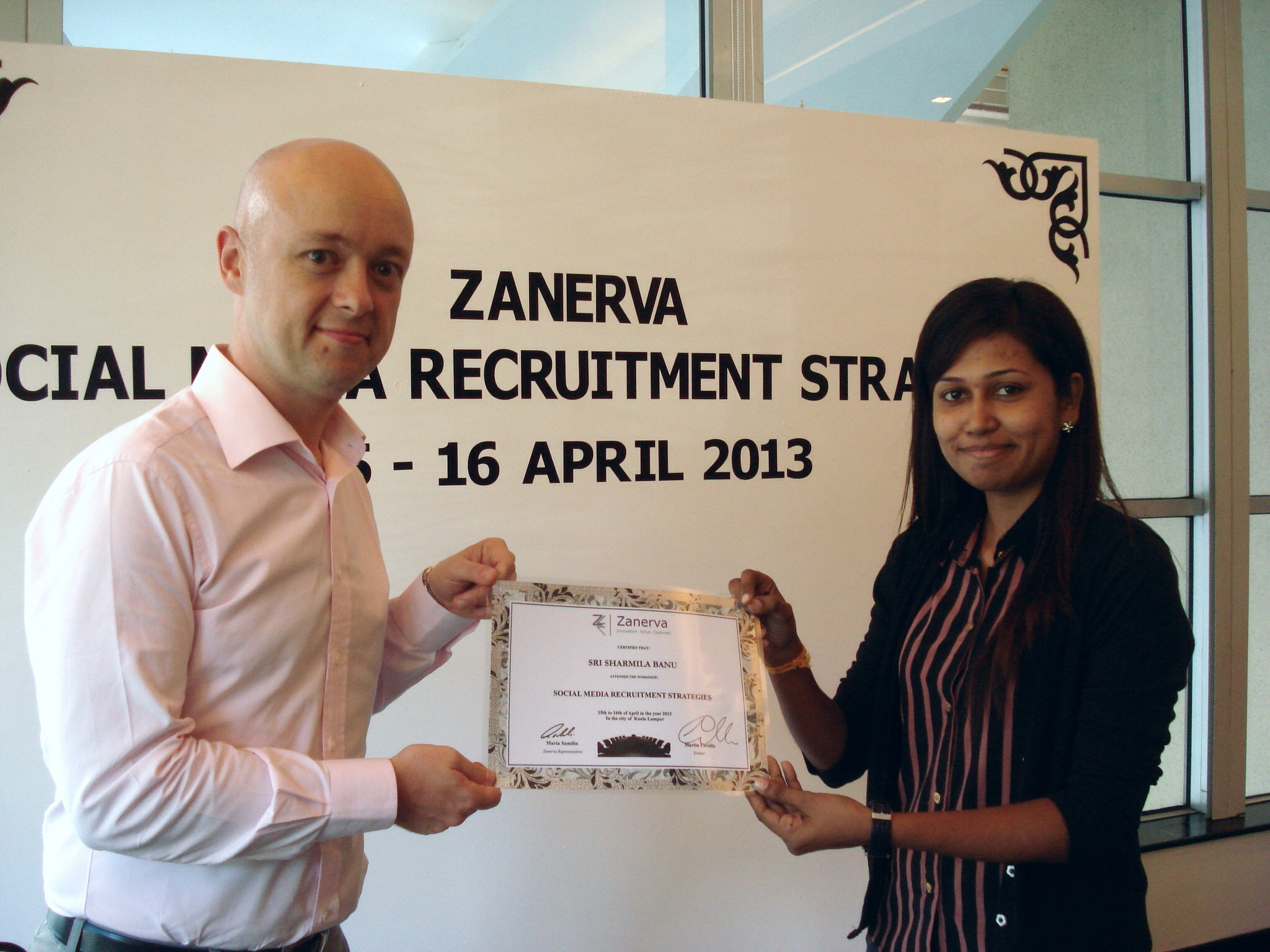 Sri Sharmilla Banu, Talent Acquisition Specialist at AUO Sunpower Sdn Bhd  receiving her certificate of participation for attending the Social Media Recruitment Strategies Workshop in Kuala Lumpur