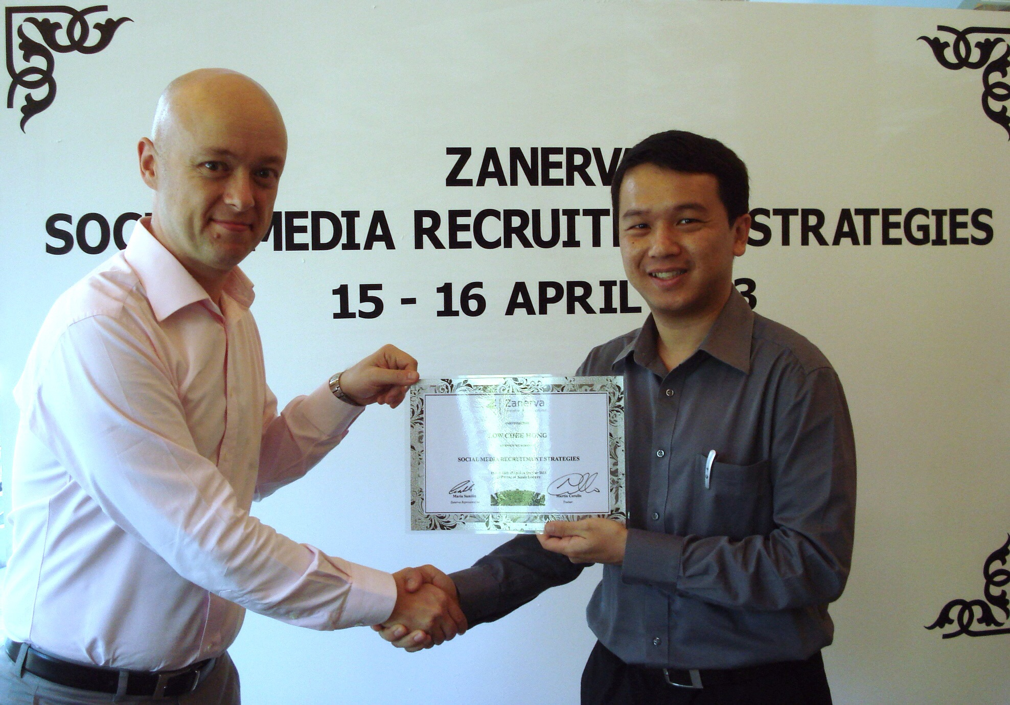 Low Chee Hong, Group Human Resource Executive at BMW Malaysia  receiving his certificate of participation for attending the Social Media Recruitment Strategies Workshop in Kuala Lumpur