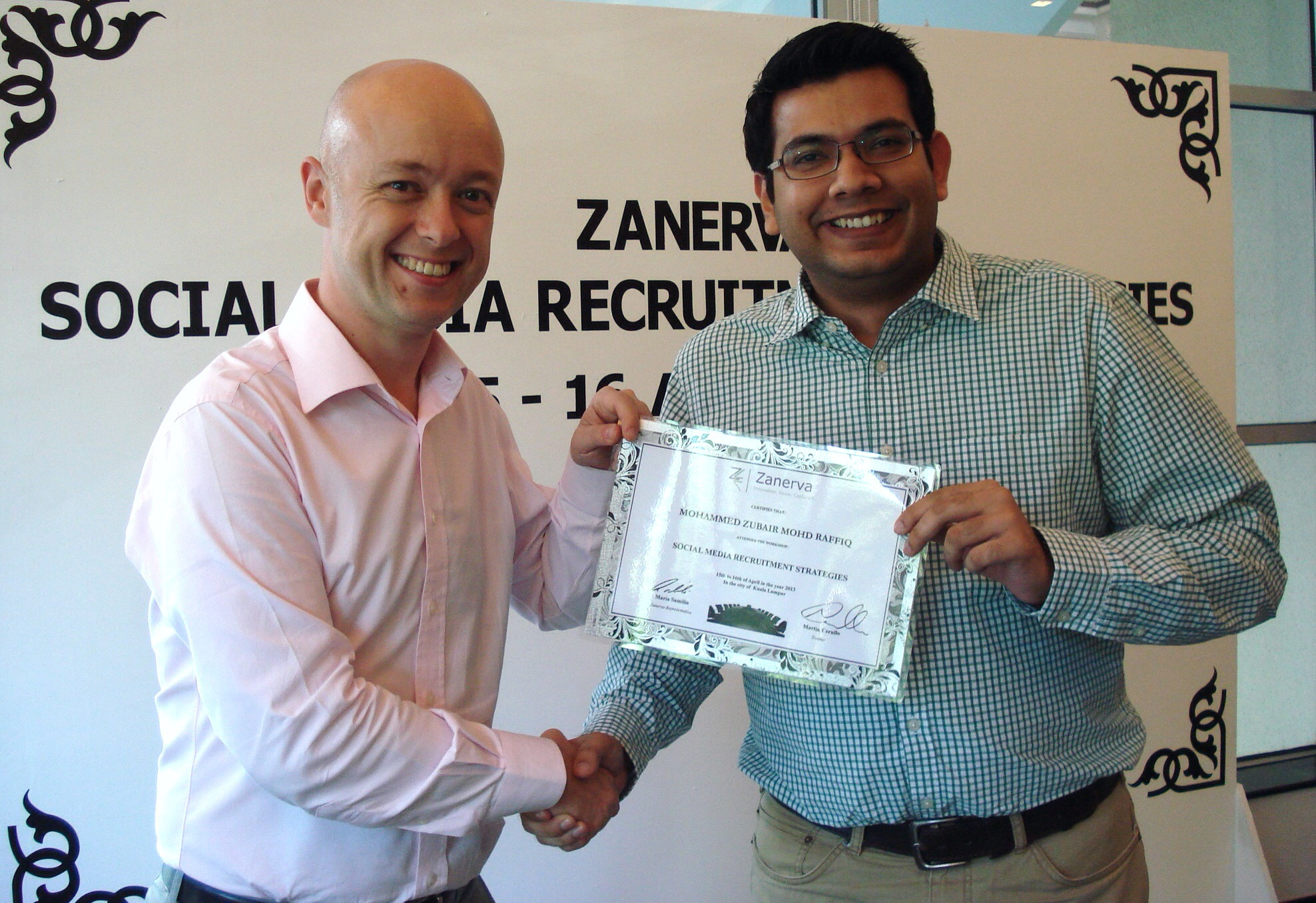 Mohammed Zubair Mohd Raffiq, Sourcing & Learning Manager at British American Tobacco Malaysia  receiving his certificate of participation for attending the Social Media Recruitment Strategies Workshop