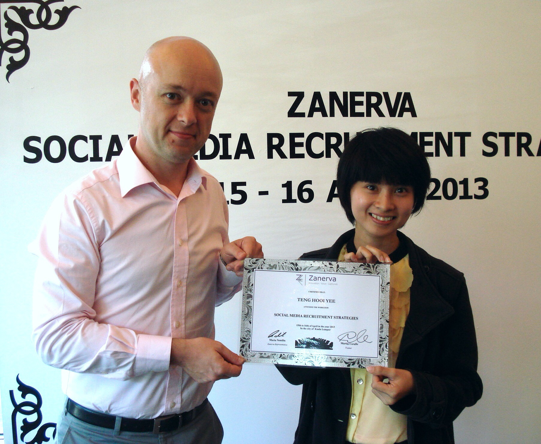 Teng Hooi Yee, Human Resource Executive at  Lotte Chemical Titian (M) Sdn Bhd   receiving her certificate of participation for attending the Social Media Recruitment Strategies Workshop in Kuala Lumpur