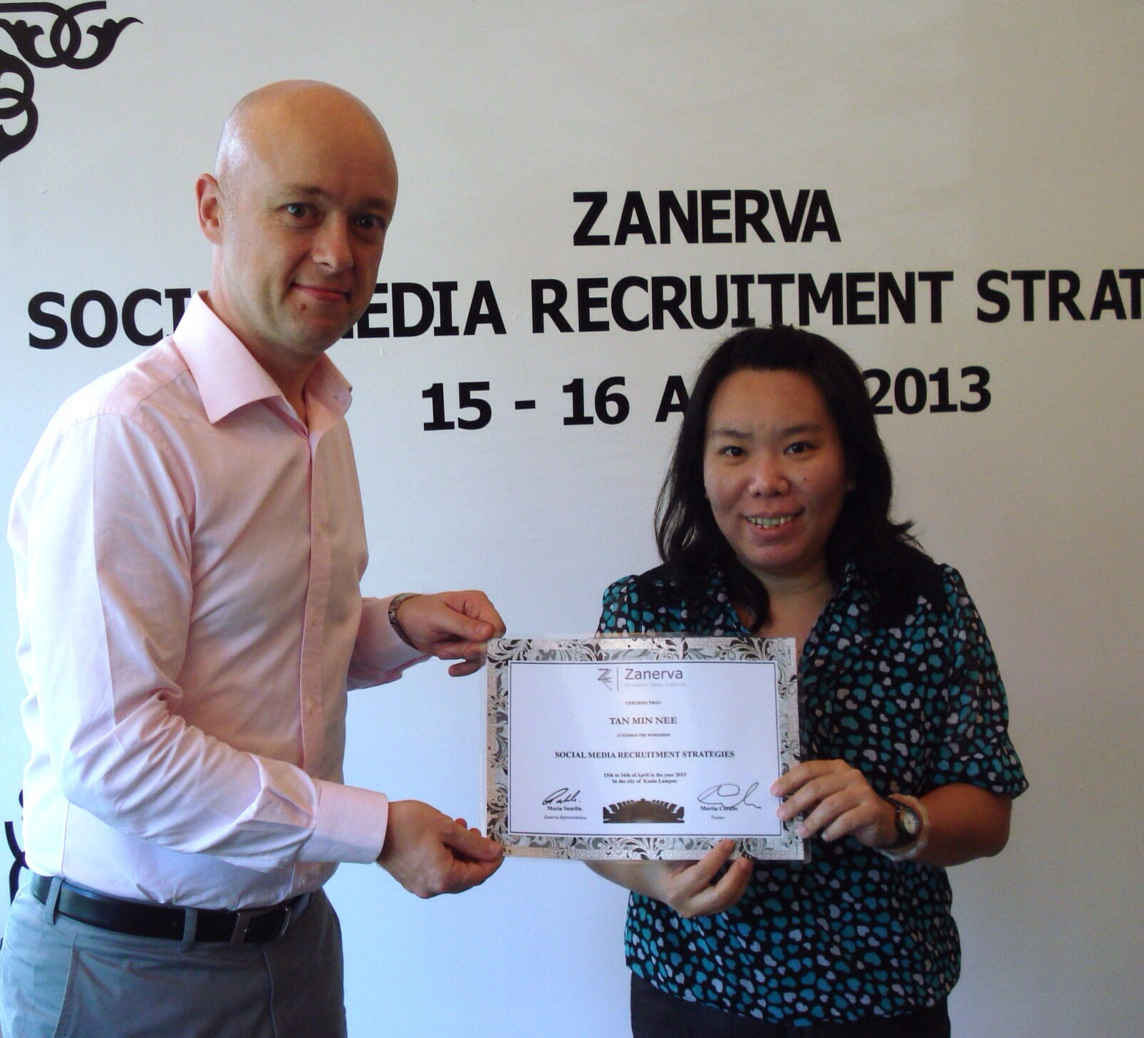 Tan Min Nee, Senior HR Generalist at Radisys (M) Sdn Bhd  receiving her certificate of participation for attending the Social Media Recruitment Strategies Workshop in Kuala Lumpur