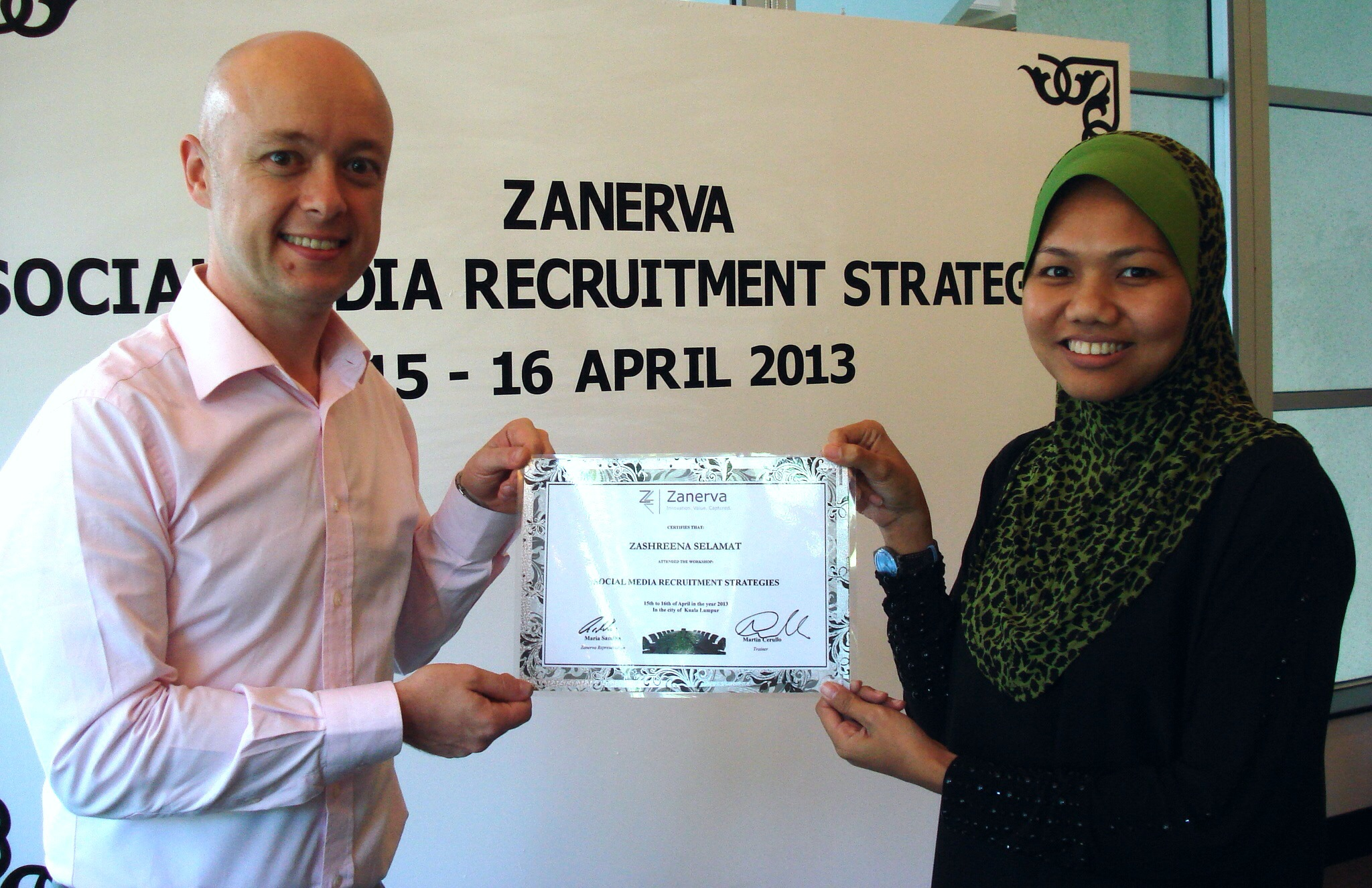 Zashreena Binti Selamat, Talent Sourcing Executive at Sapura Kencana Petroleum  receiving her certificate of participation for attending the Social Media Recruitment Strategies Workshop in Kuala Lumpur