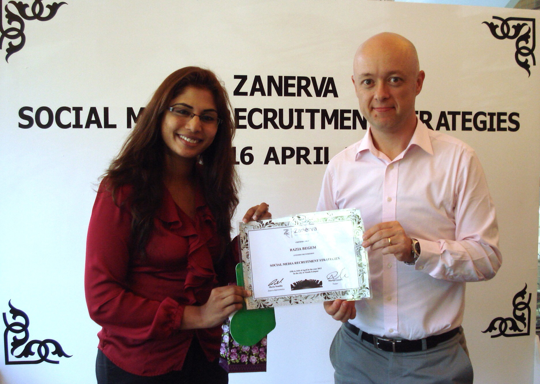 Razia Begem, Recruitment Lead at Xchanging Asia Pacific Sdn Bhd  receiving her certificate of participation for attending the Social Media Recruitment Strategies Workshop in Kuala Lumpur