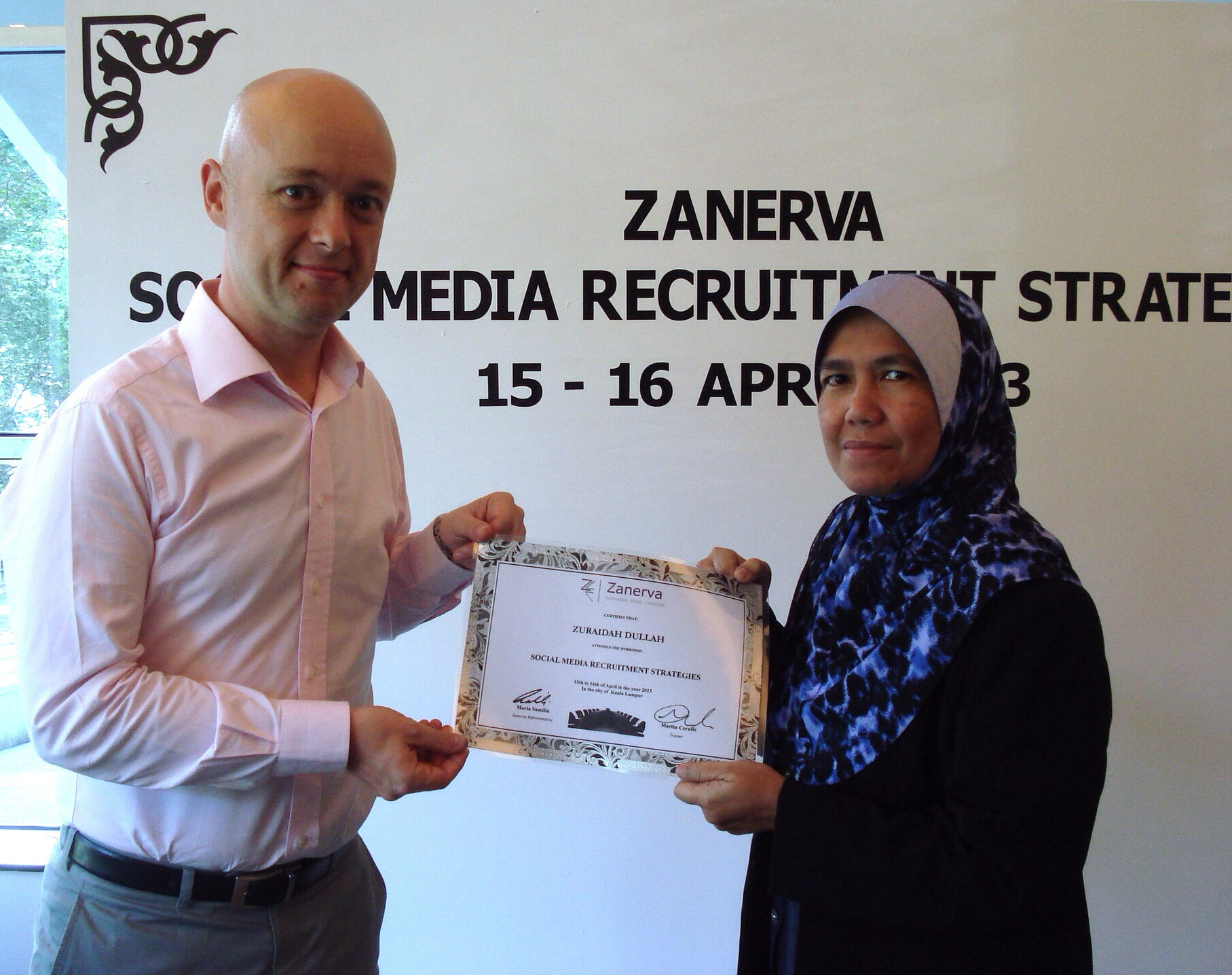 Zuraidah Dullah, Senior Manager (Staffing Management) at Sabah Electricity Sdn Bhd  receiving her certificate of participation for attending the Social Media Recruitment Strategies Workshop in Kuala Lumpur
