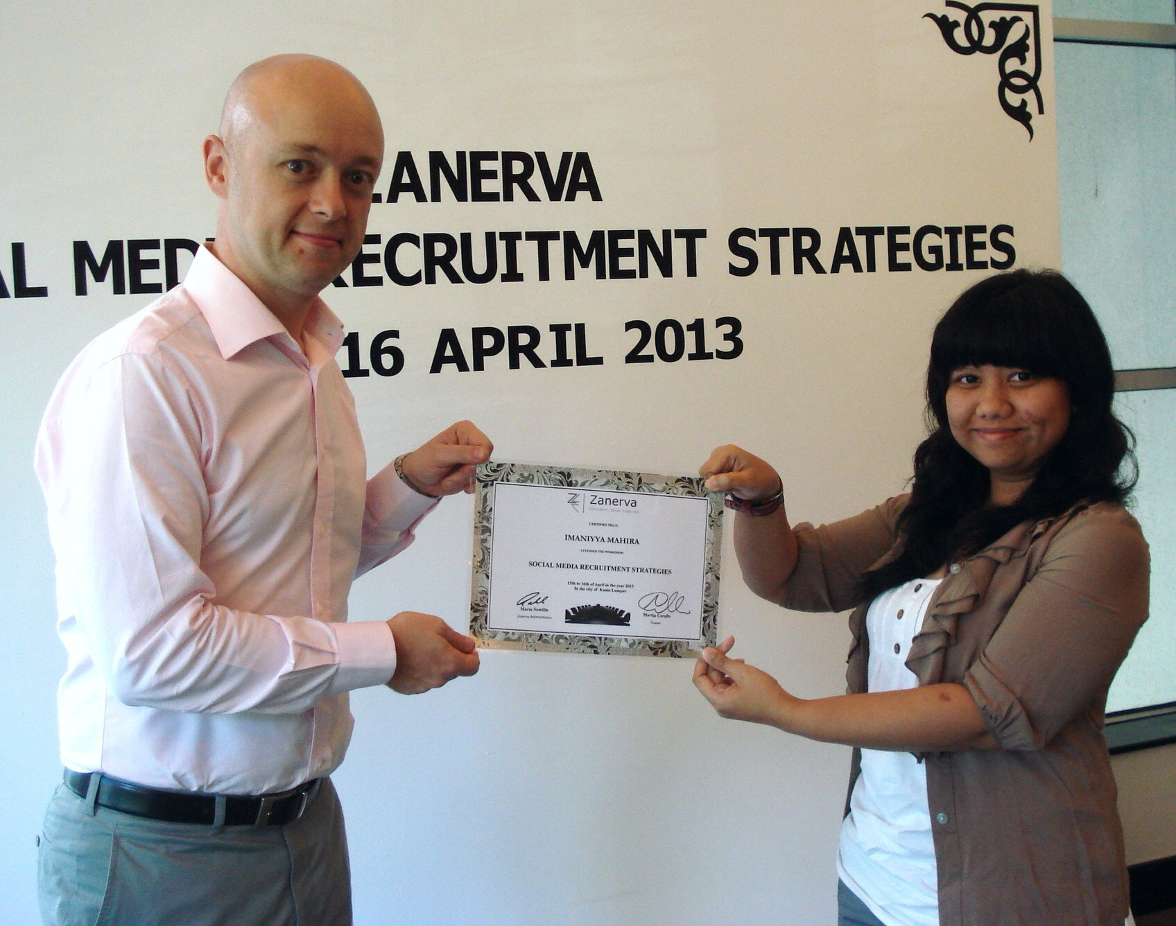 Imaniyya Mahira, Associate Resource Development Manager at Nutricia Indonesia Sejahtera  receiving her certificate of participation for attending the Social Media Recruitment Strategies Workshop in Kuala Lumpur