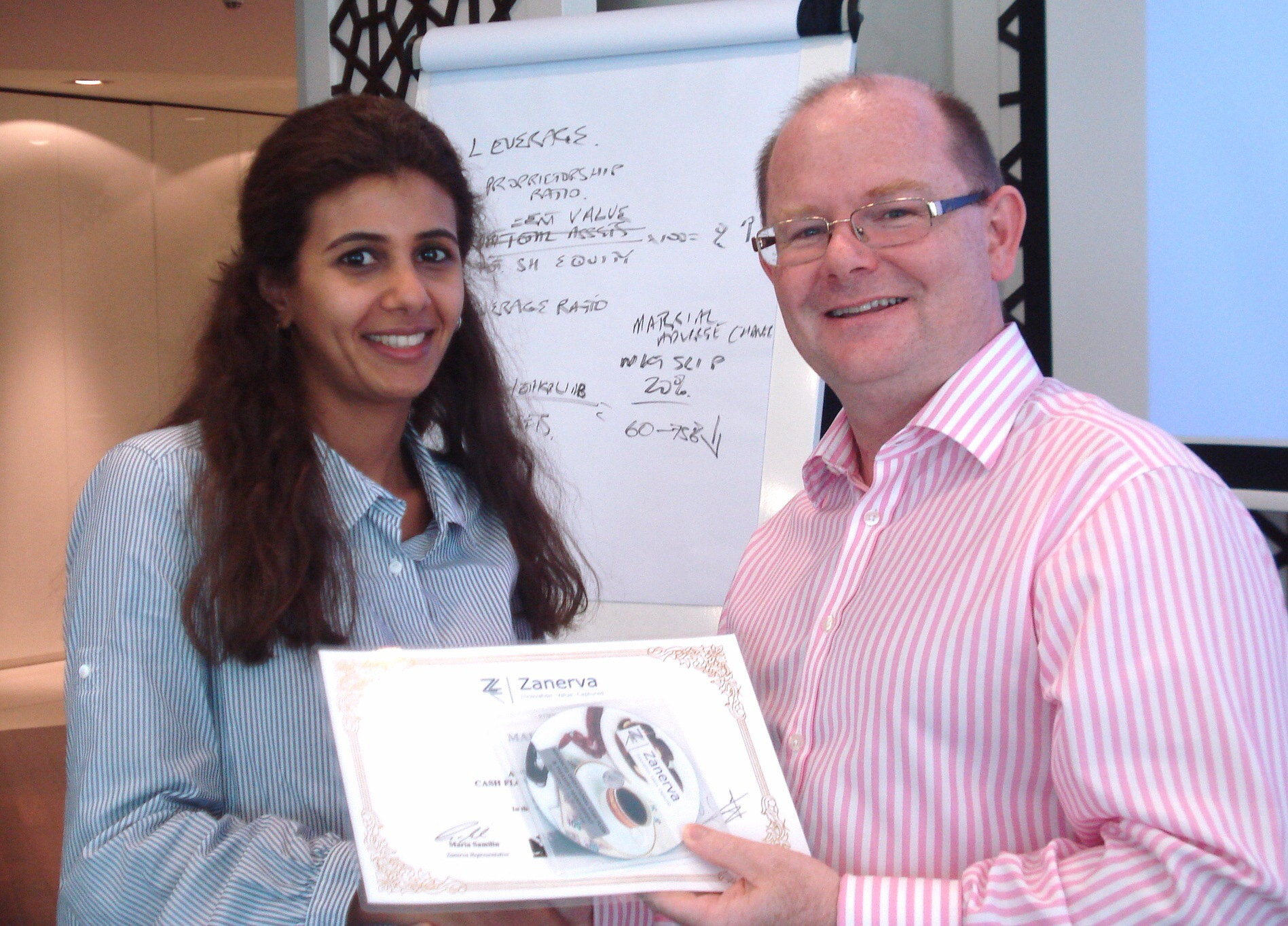 Mai Al Mutair Group Investment Manager atZain Mobil Telecommunications Kuwait receiving her certificate of participation for attending the Advanced Operational Cash Flow & Liquidity Risk Management workshop in Dubai