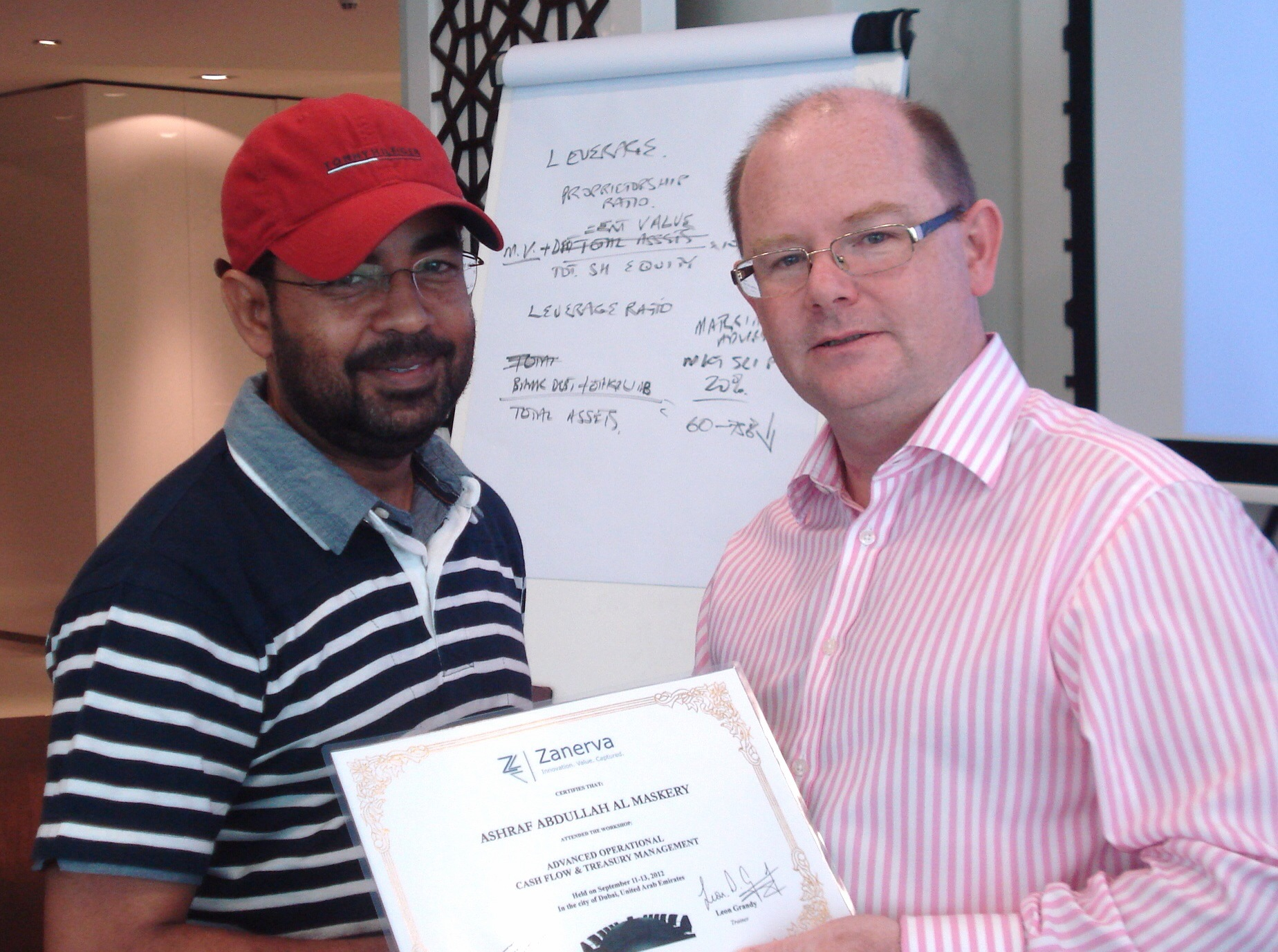 Ashraf Abdullah Al Maskery, Accountant at The Wave Muscat  receiving his certificate of participation for attending the Advanced Operational Cash Flow & Liquidity Risk Management workshop in Dubai