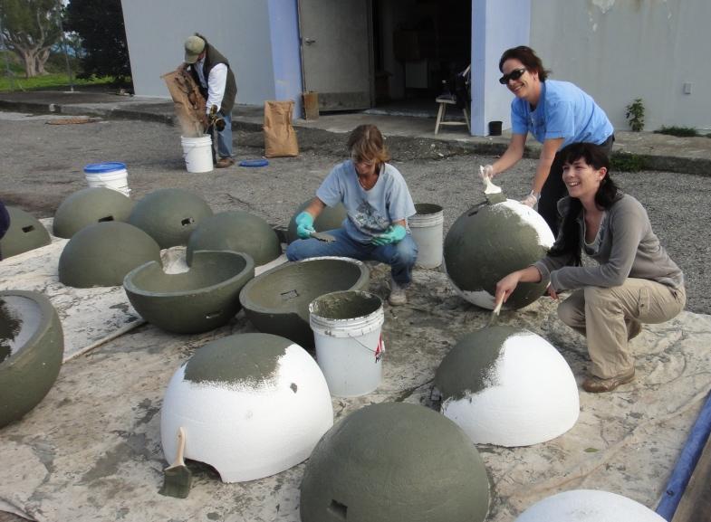 Bermuda Audubon Society volunteers coating styrofoam igloos