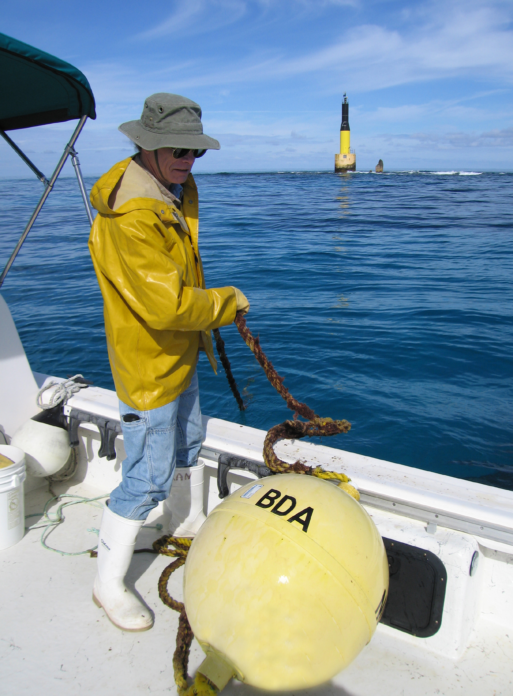 Anson Nash working on the mooring buoy in the North Rock protected area