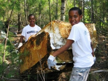 Clearwater Middle School students removing a fridge from Officer's Beach