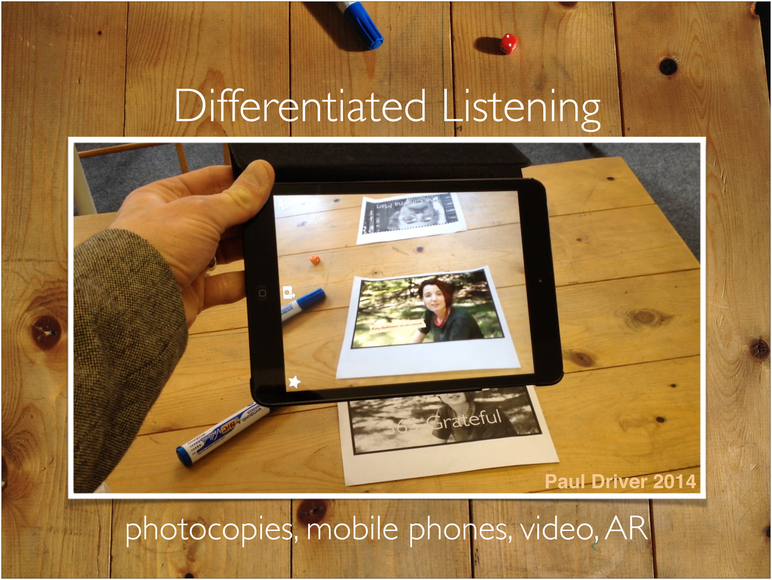 This year I've been using augmented reality to create differentiated video listenings for my fairly diverse intermediate group. Learners can take control of the material and listen multiple times. Using the headphones connected to their mobile devices they can simultaneously work on different (though thematically linked) material. The headphones also enable them to listen in a more focused way.