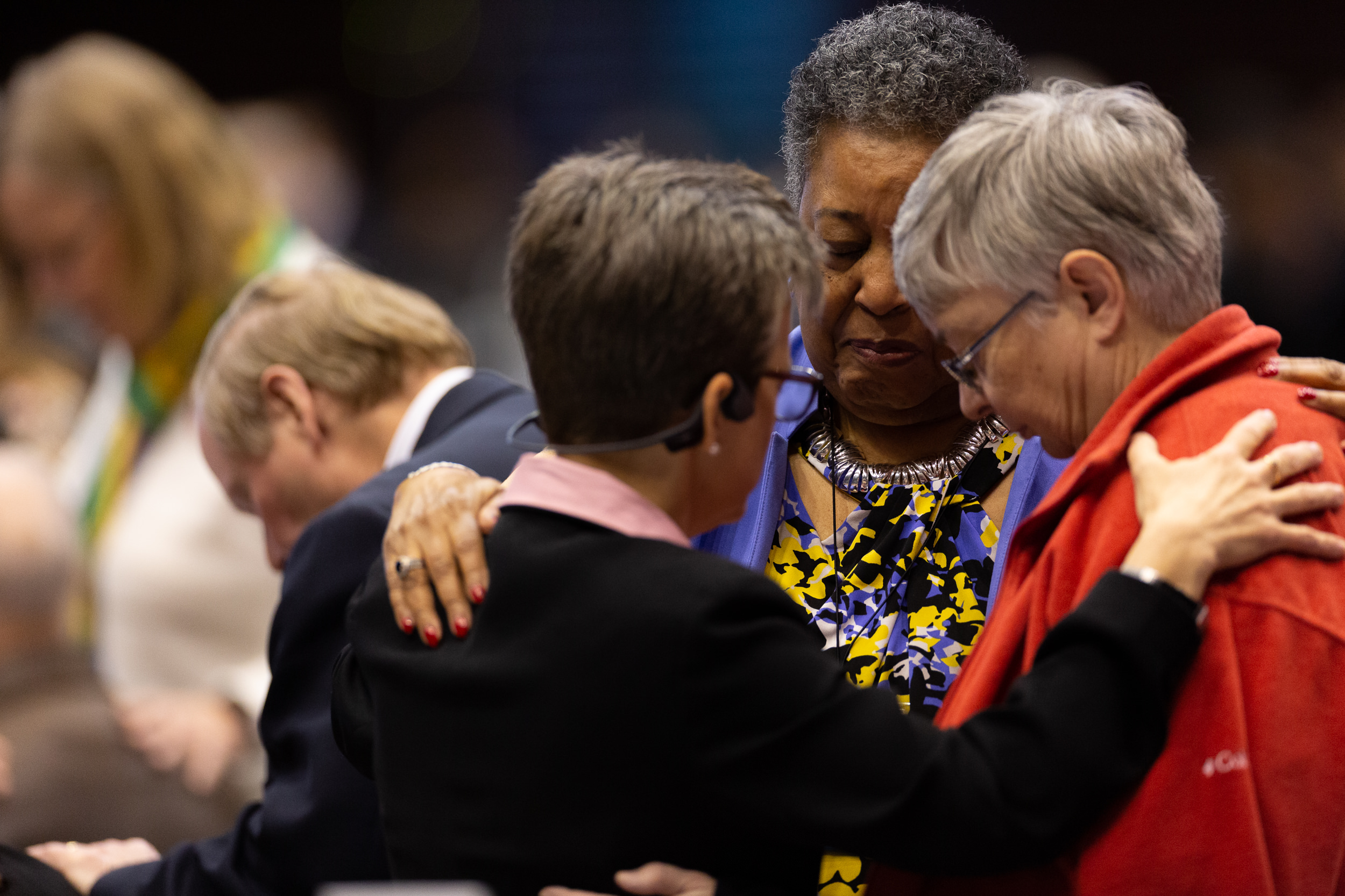 Delegates Pray before their work at the Special Called General Conference of the United Methodist Church in 2019