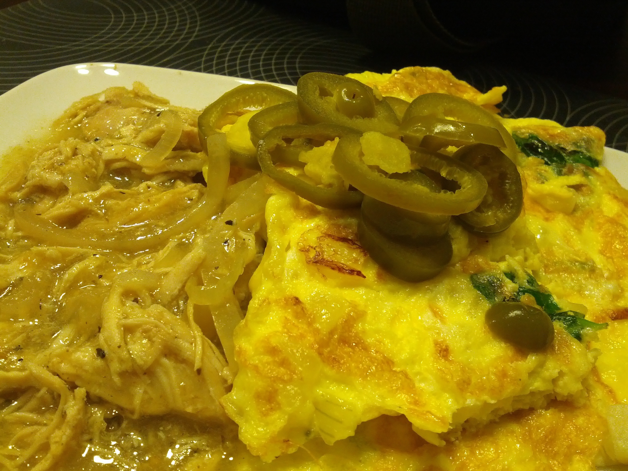 Tuesday morning breakfast, chicken chili con verde with scrambled eggs and jalapenos.