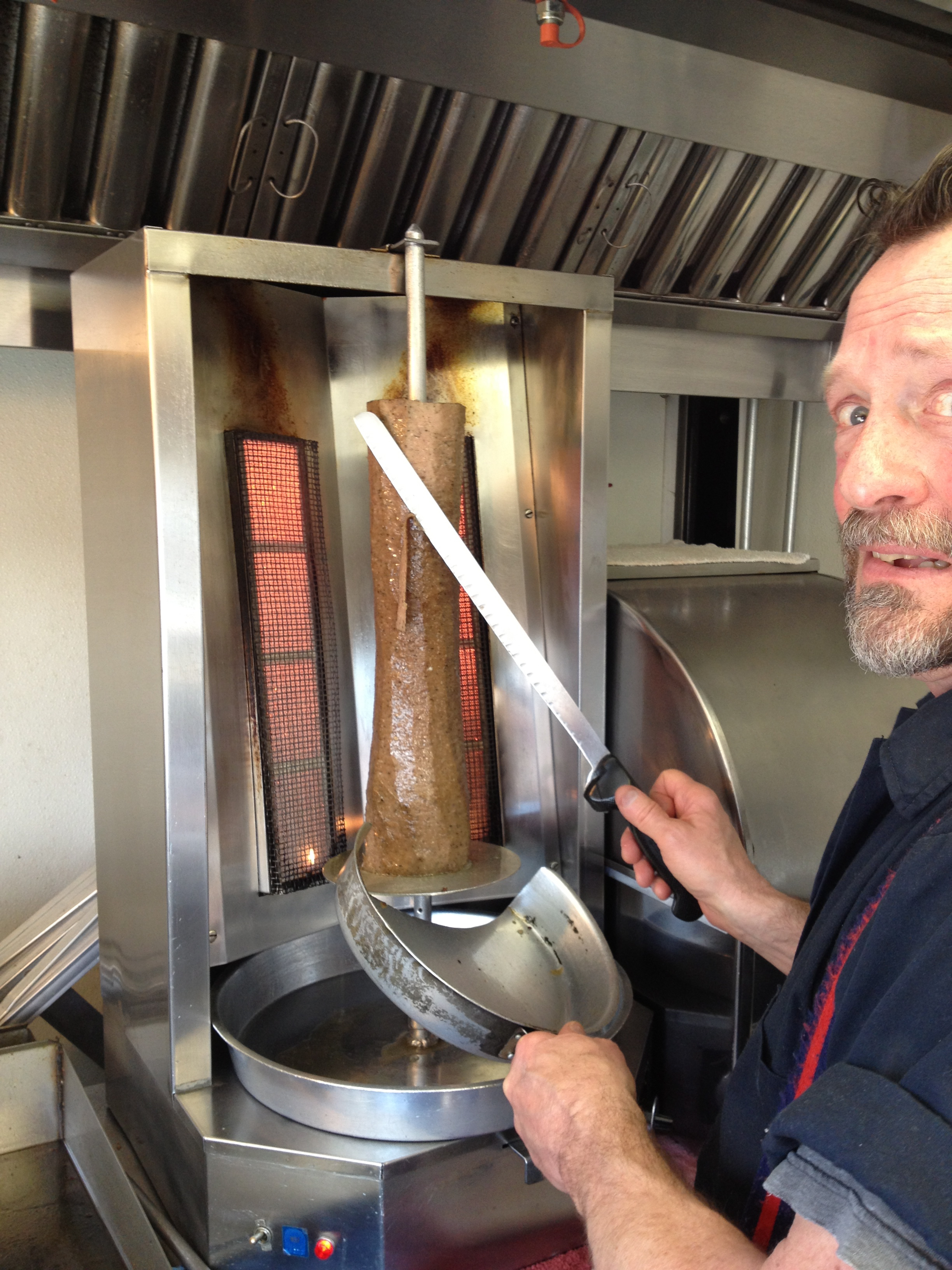 Rich at the Gyros Spot uses traditional rotisserie style meat