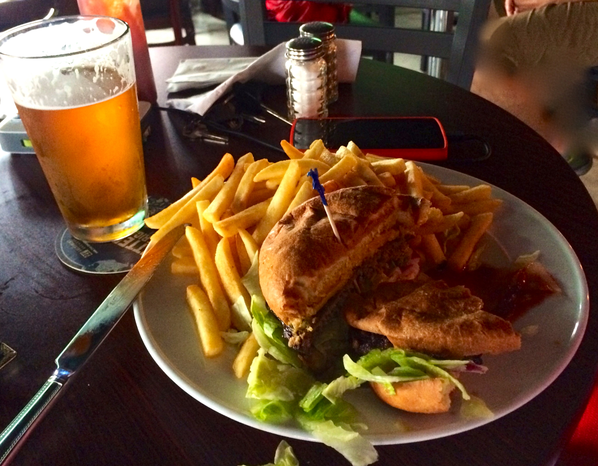 Burger and fries with a brew
