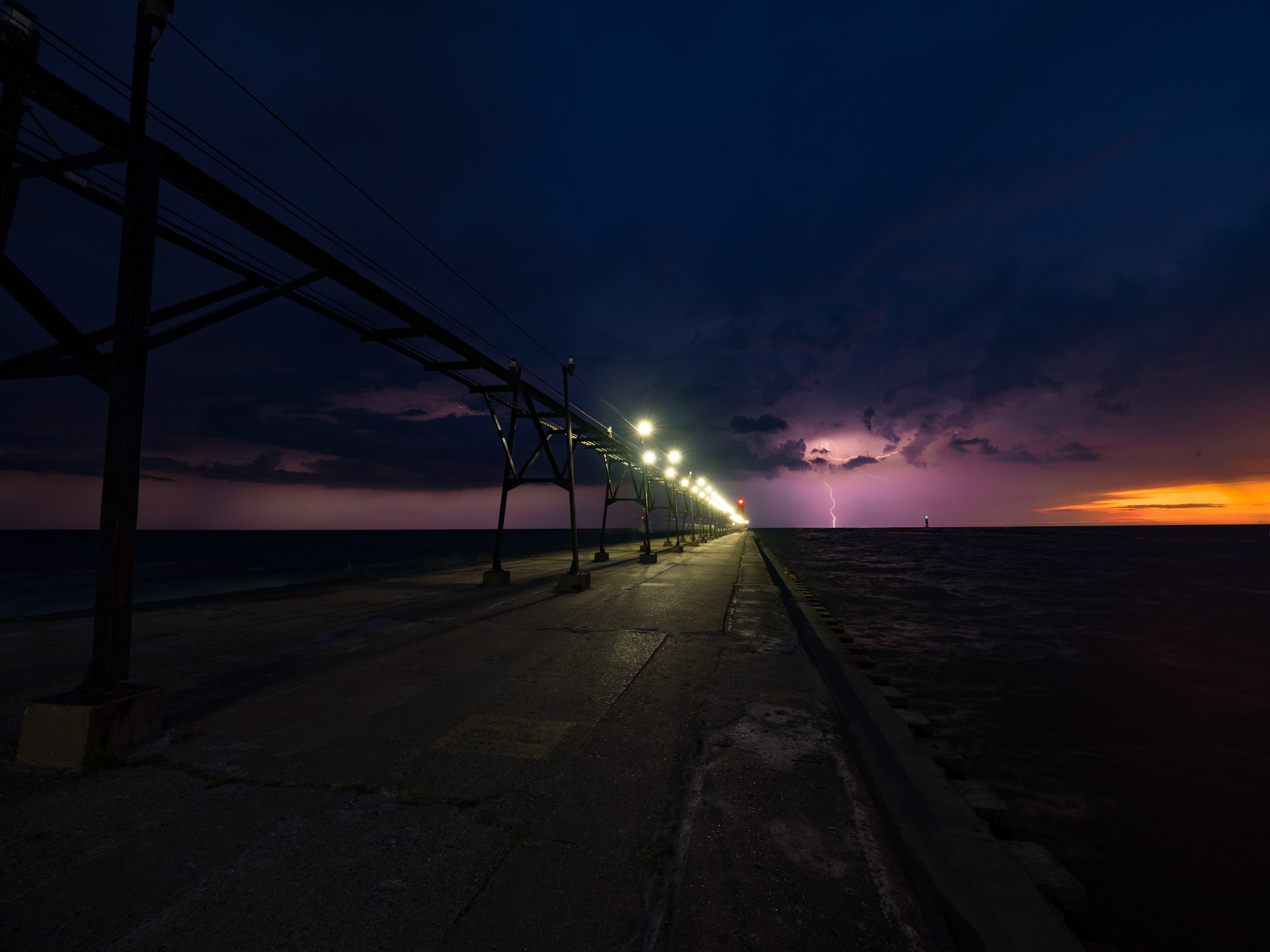 The setting sun and lightning all in one shot! Made with the  Olympus OM-D E-M1  and mZuiko  7-14mm f/2.8 PRO