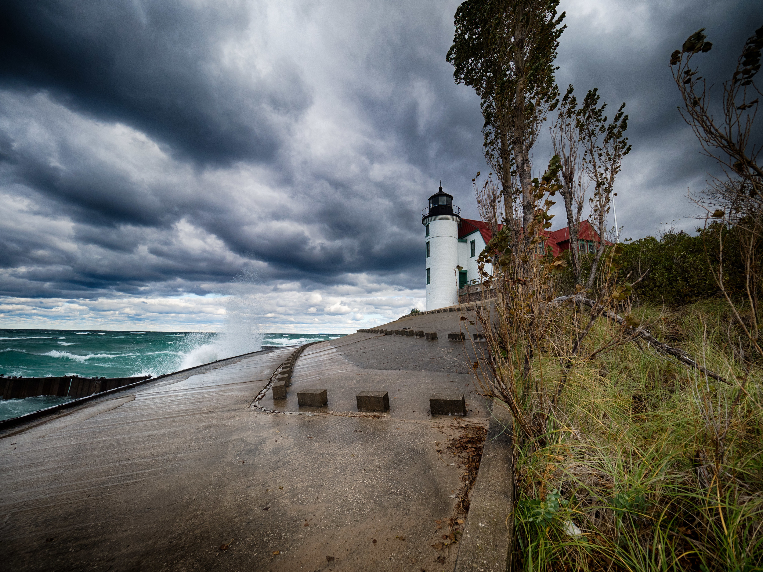 Point Betsey Lighthouse being blasted by a turbulent Lake Michigan. It was cold, and blustery, but it was worth every second to be there.