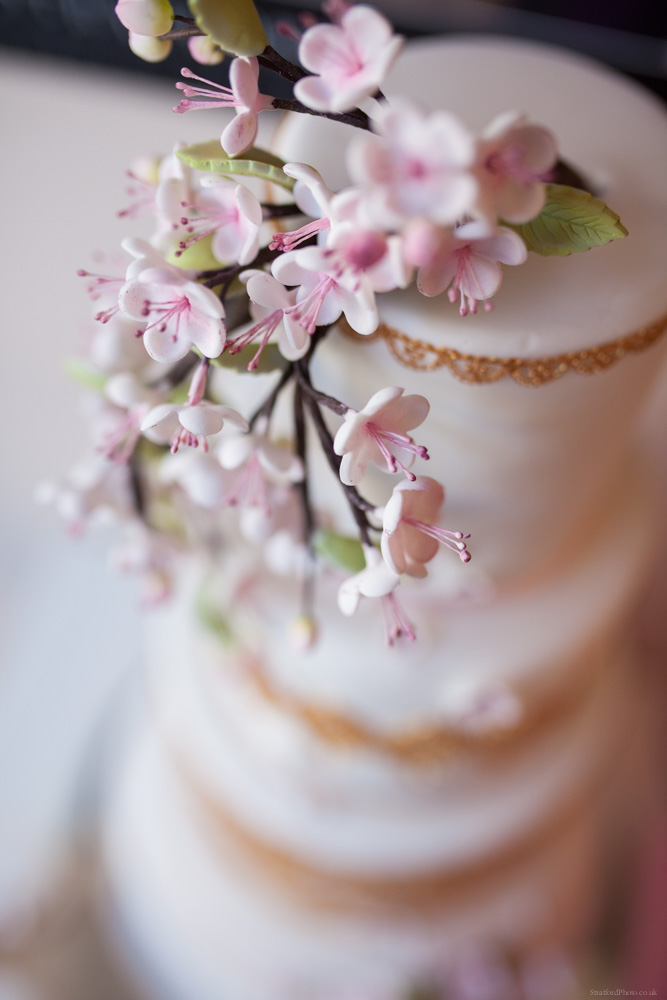 White wedding cake with floral decoration by bella cake pantry 1