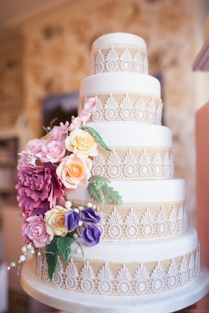 White wedding cake with floral decoration by bella cake pantry 2