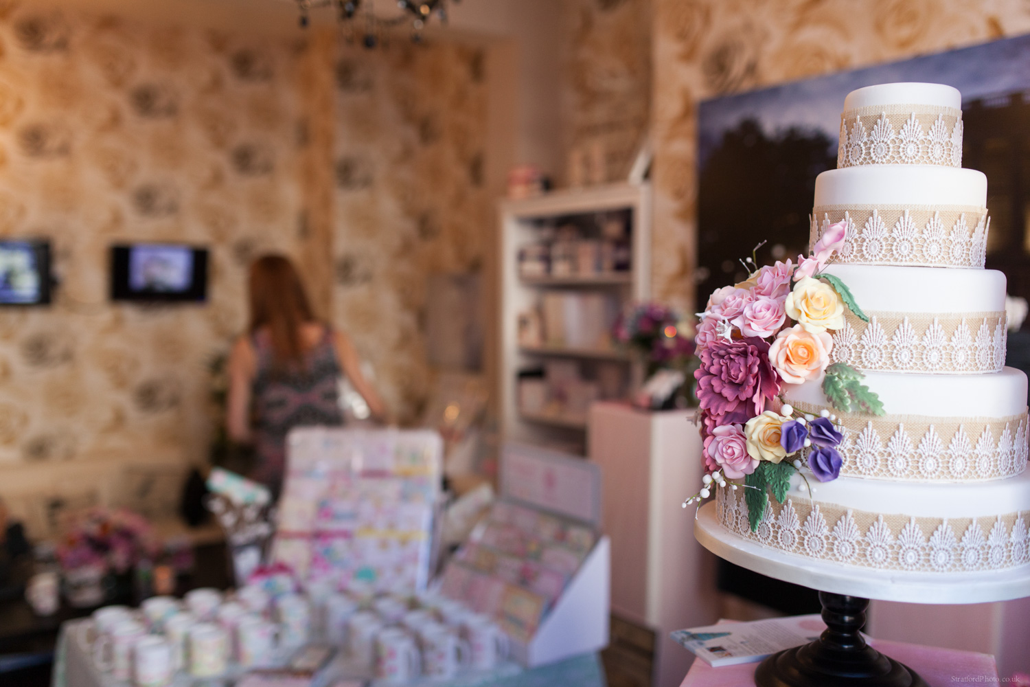 White wedding cake with floral decoration by bella cake pantry in blue orchid hoylake