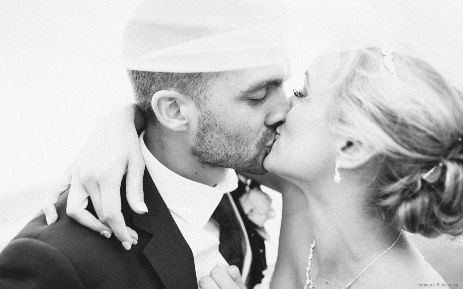 A bride and groom share a passionate kiss under her veil on their wedding day at Leasowe Castle Wirral