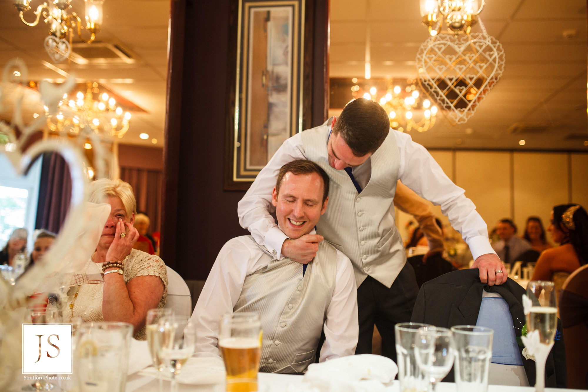A groom play fights with his best man during his speech.jpg