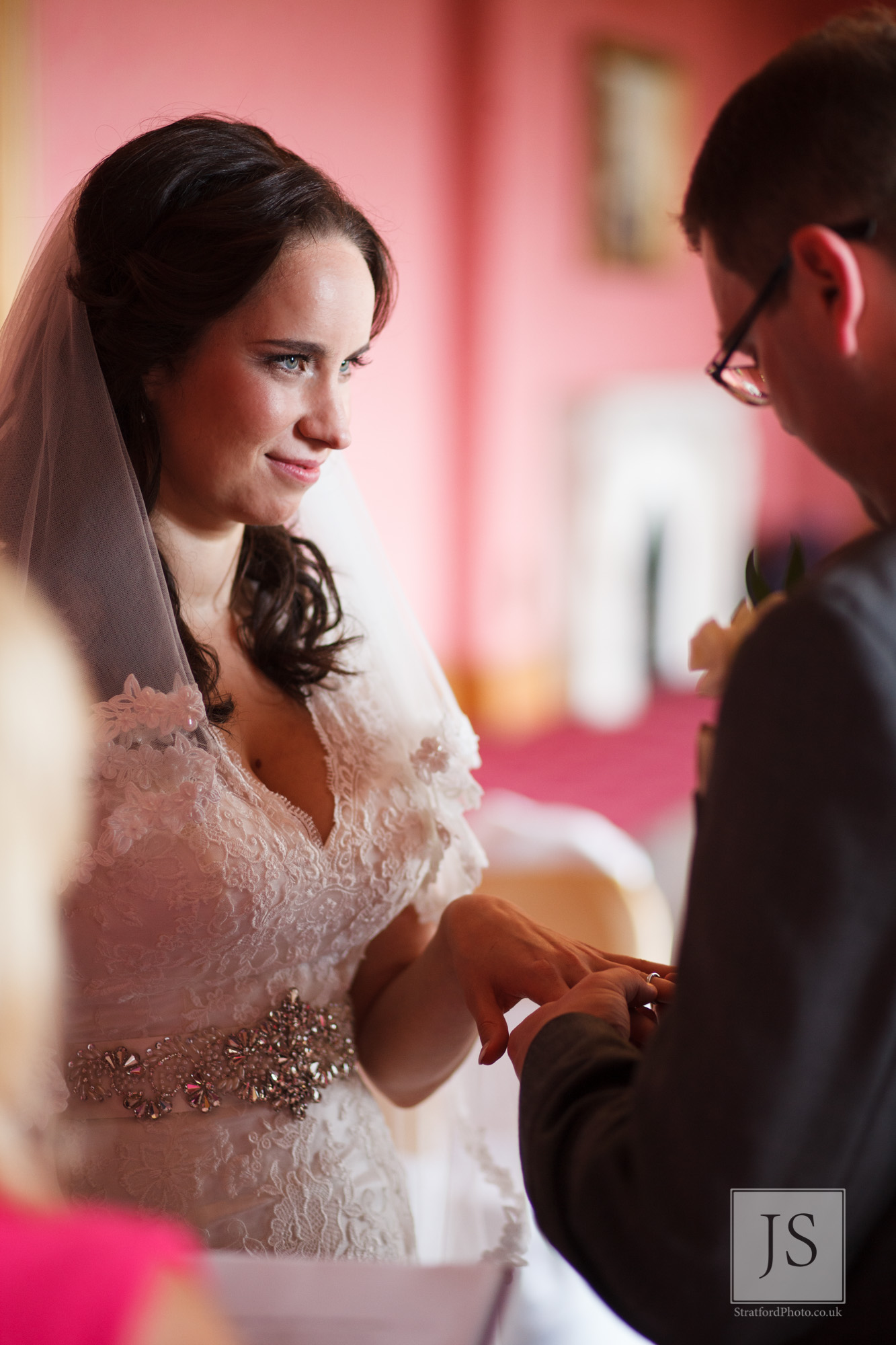 A bride recieves her wedding ring at Haigh Hall.jpg