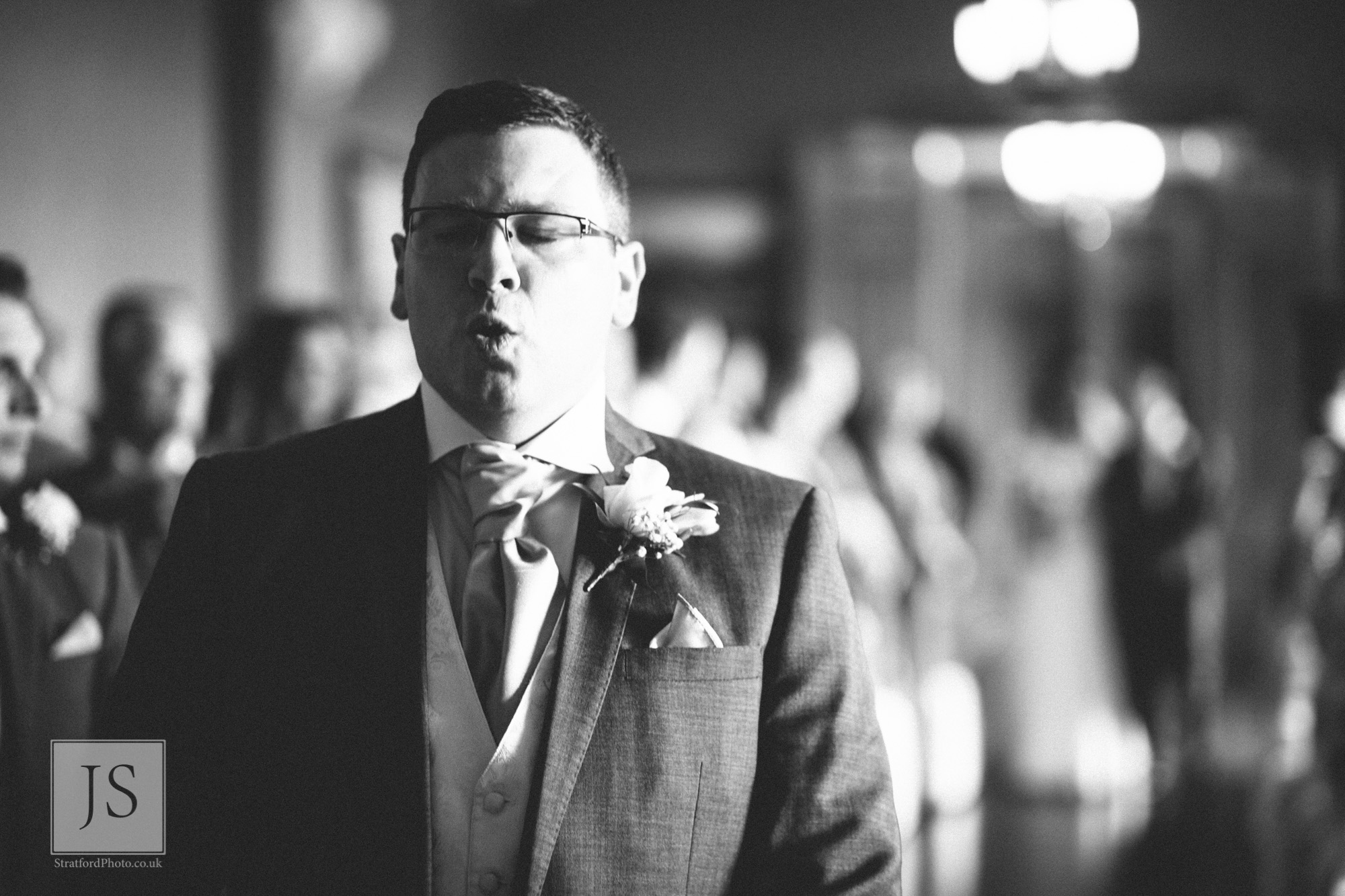 A nervous groom waits for his bride at Haigh Hall.jpg