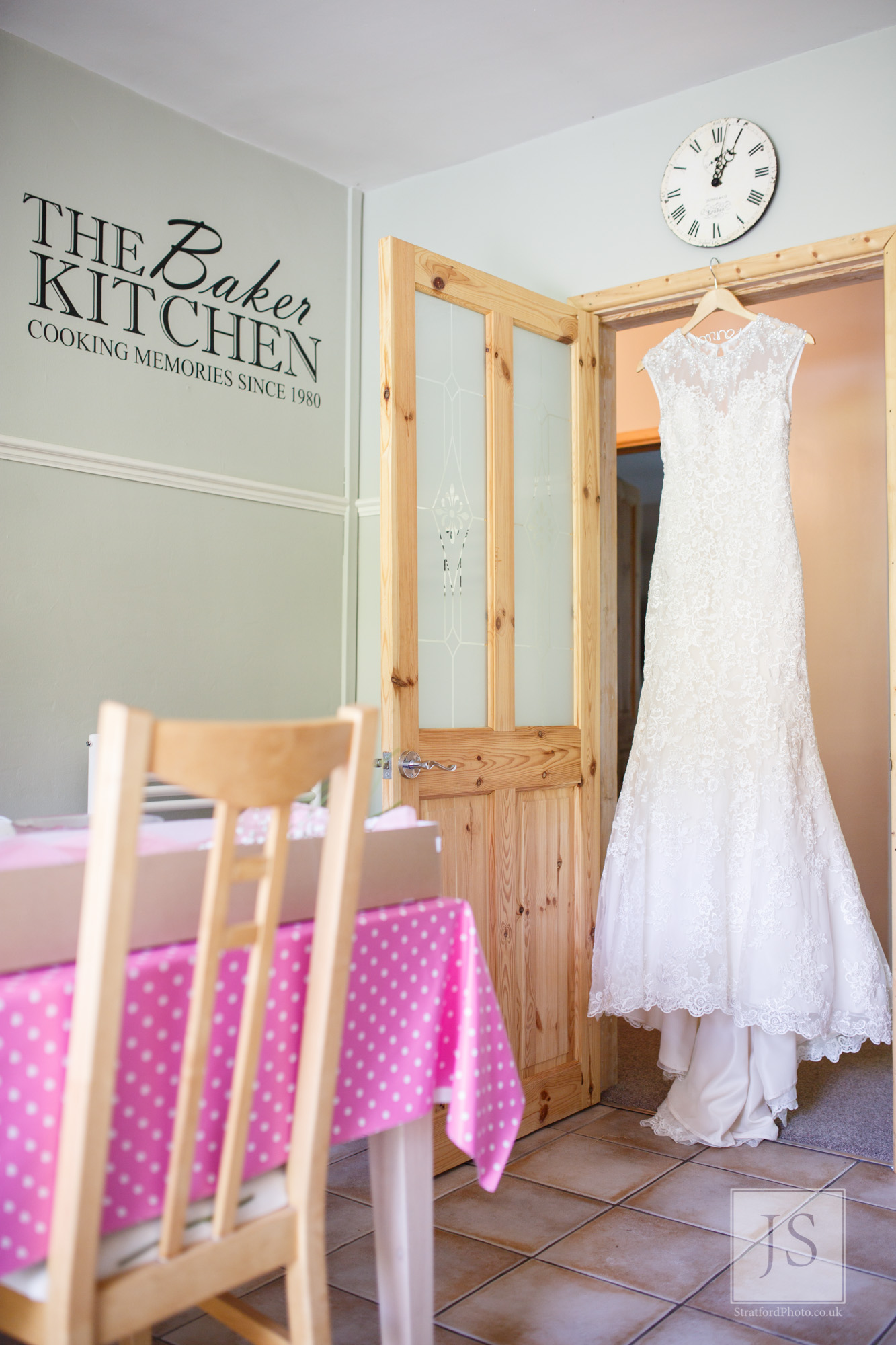 A wedding dress hangs in the family kitchen doorway.jpg