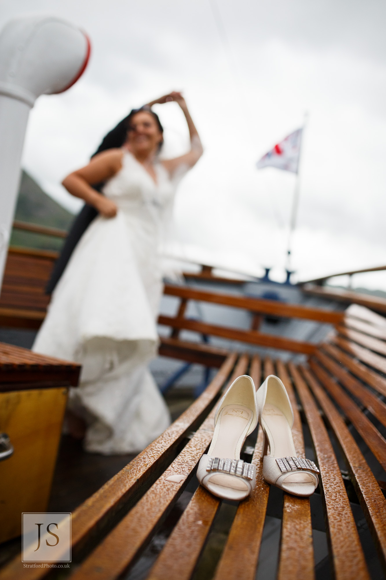 A bride and groom dance together on a Lake Ullswater steamer boat.jpg