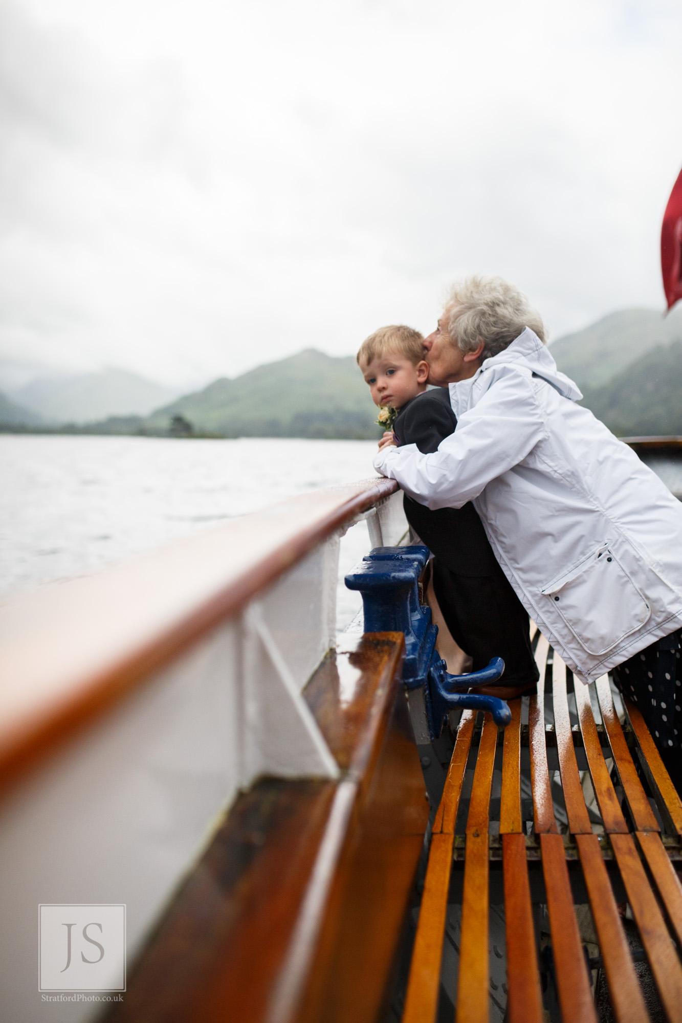 A grandmother kisses her grandson on Lake Ullswater.jpg