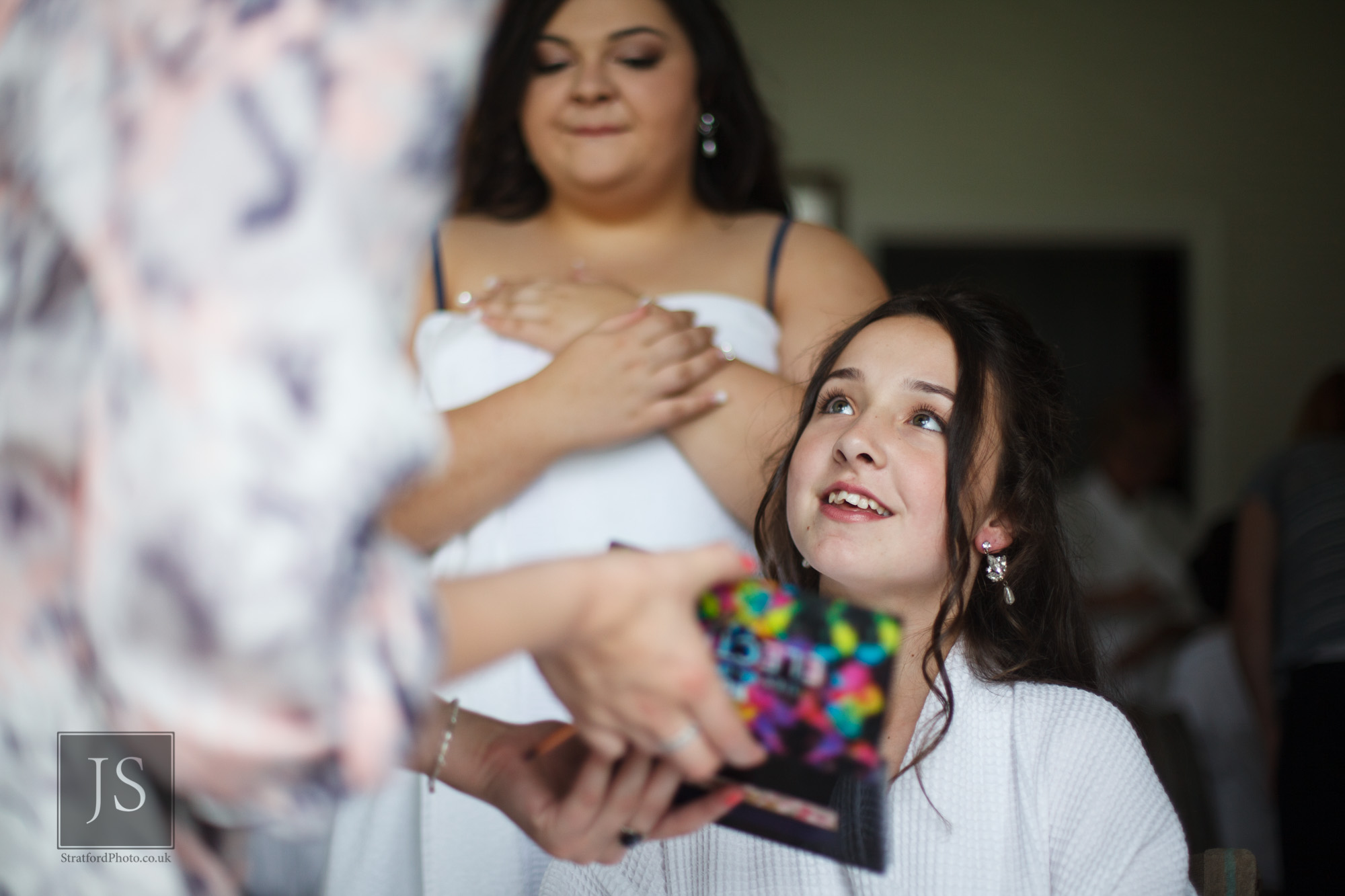 A young bridesmaid adires her makeup.jpg